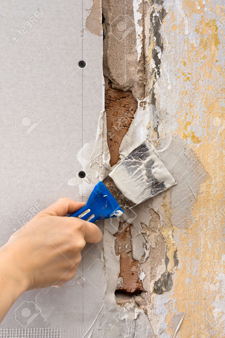 Hand Plastering A Wall With Spatula During Repair Stock Photo ...