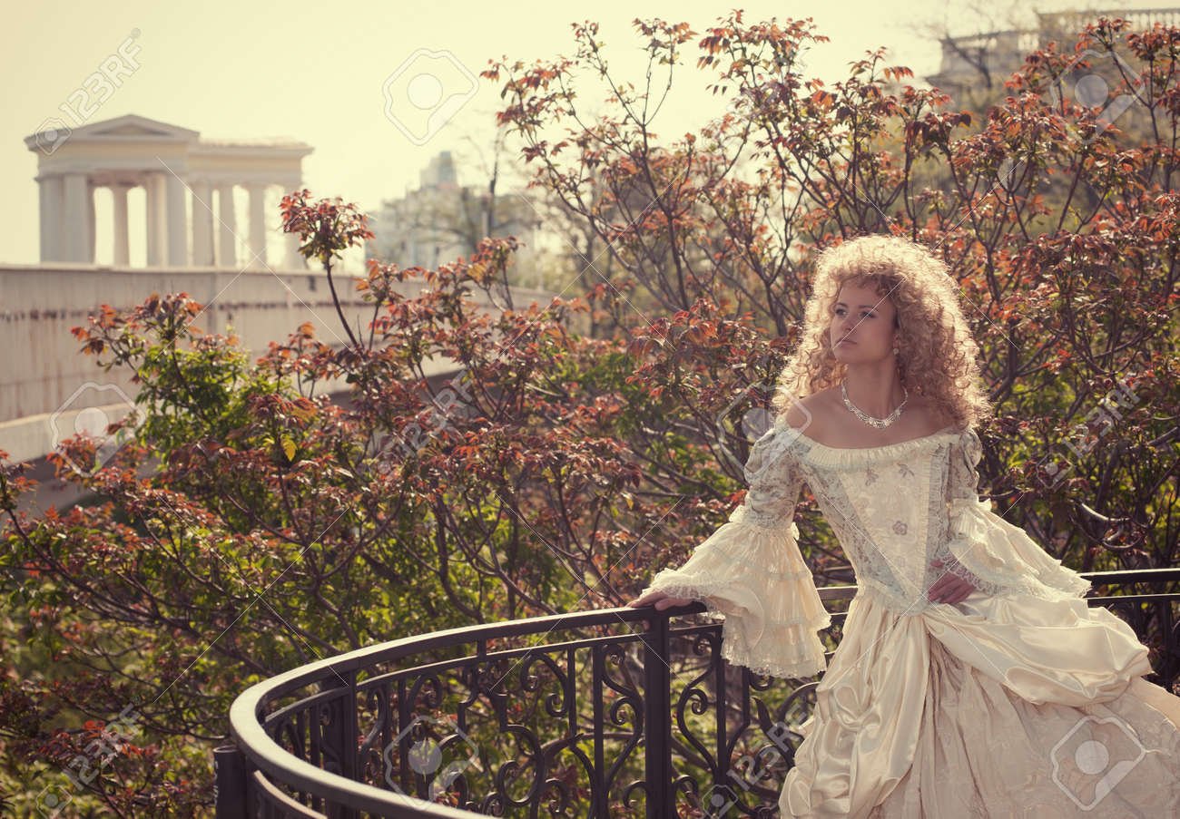 Beautiful woman in medieval dress on the balcony Stock Photo - 12019481
