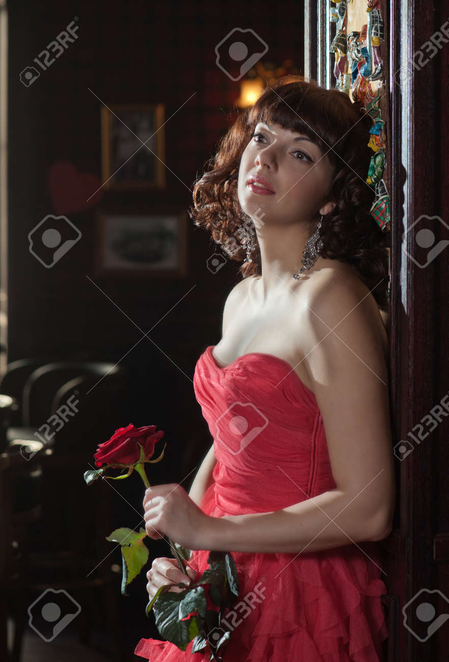 Dreamy woman in red with the rose Stock Photo - 15276000