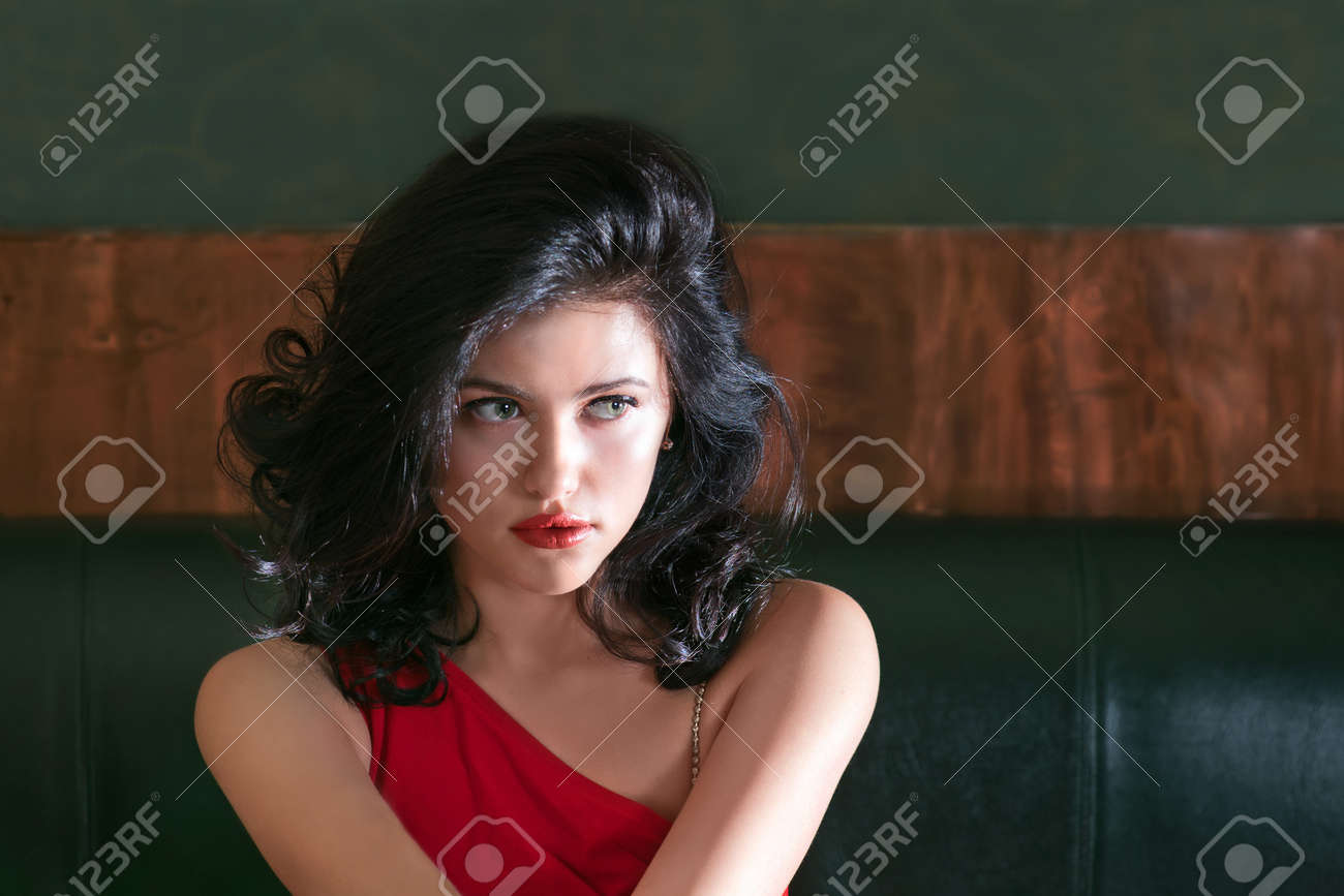 Portrait of brunette girl in red dress with the luxuriant hair Stock Photo - 15684077