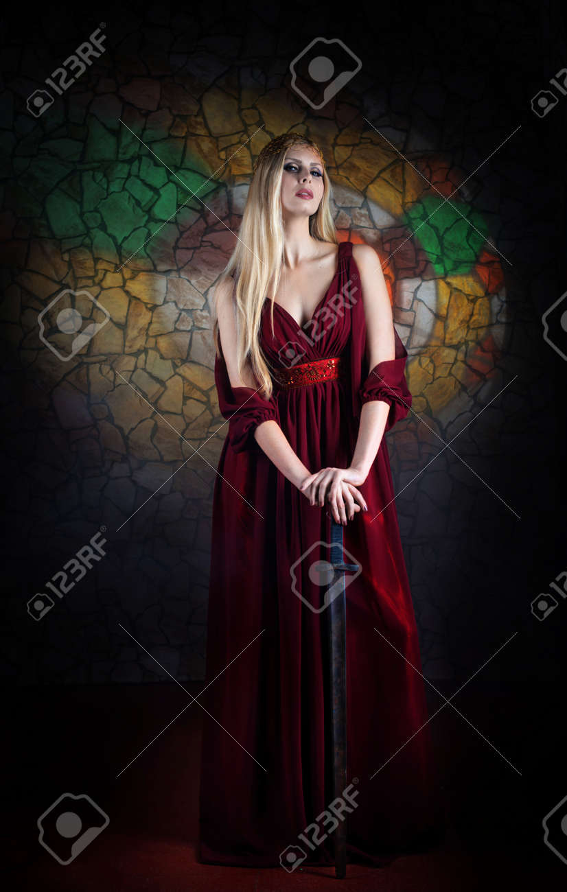 Portrait of woman in medieval dress with the sword Stock Photo - 18844043