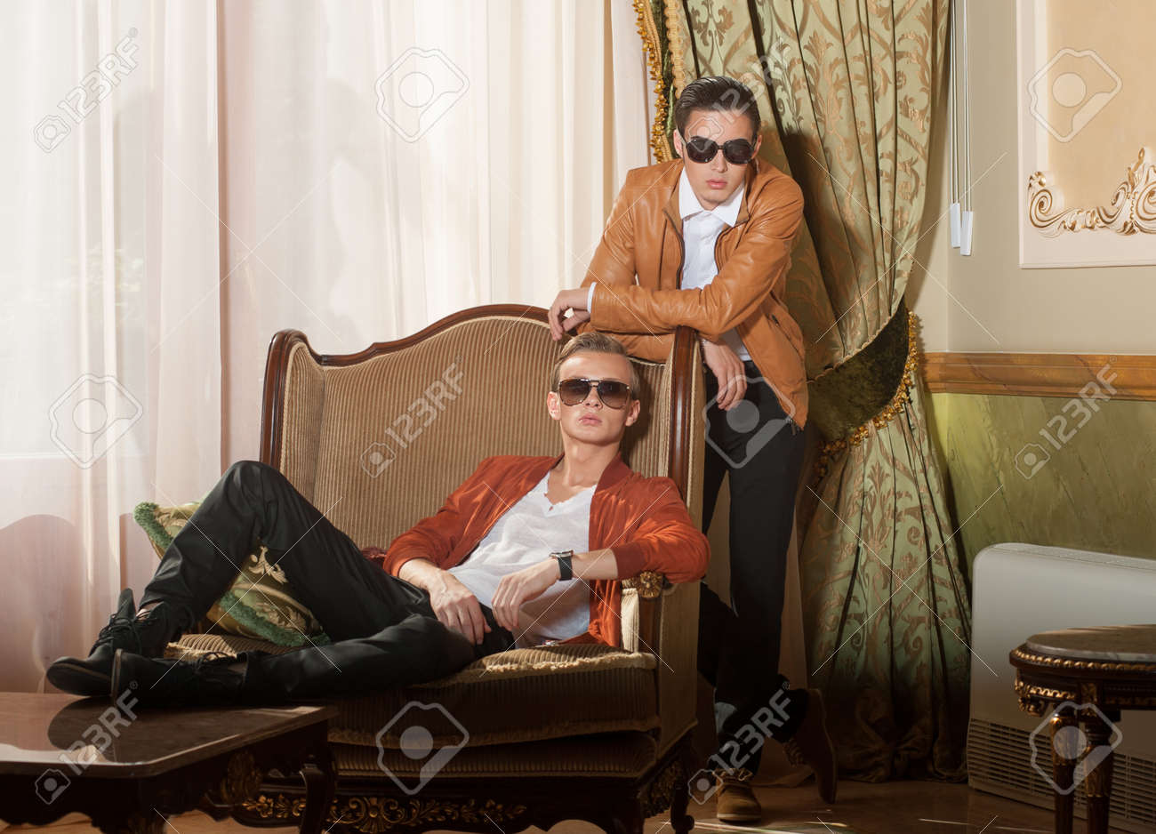 Indoors portrait of two young men in sunglasses Stock Photo - 20904831
