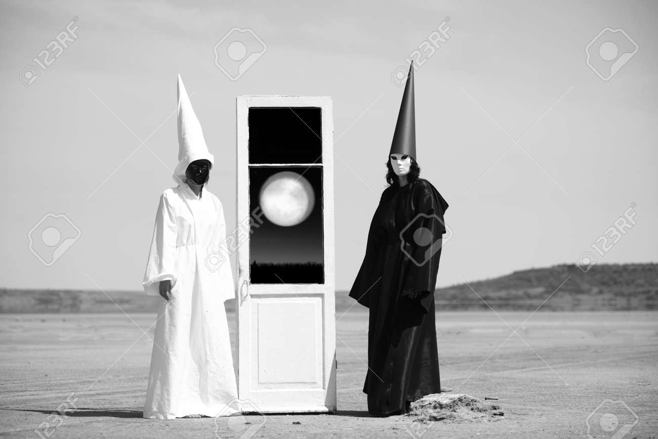 Stock Photo - Two strange people in black cloak and white cloak and the door into another world Artwork & Two Strange People In Black Cloak And White Cloak And The Door ...