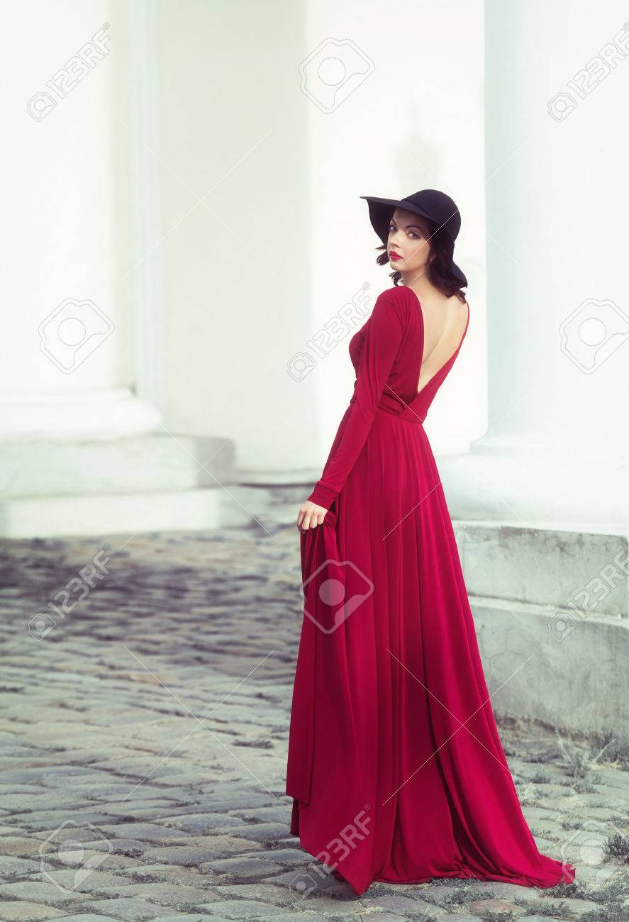 Woman In The Long Red Dress Looking Back Stock Photo- Picture And ...