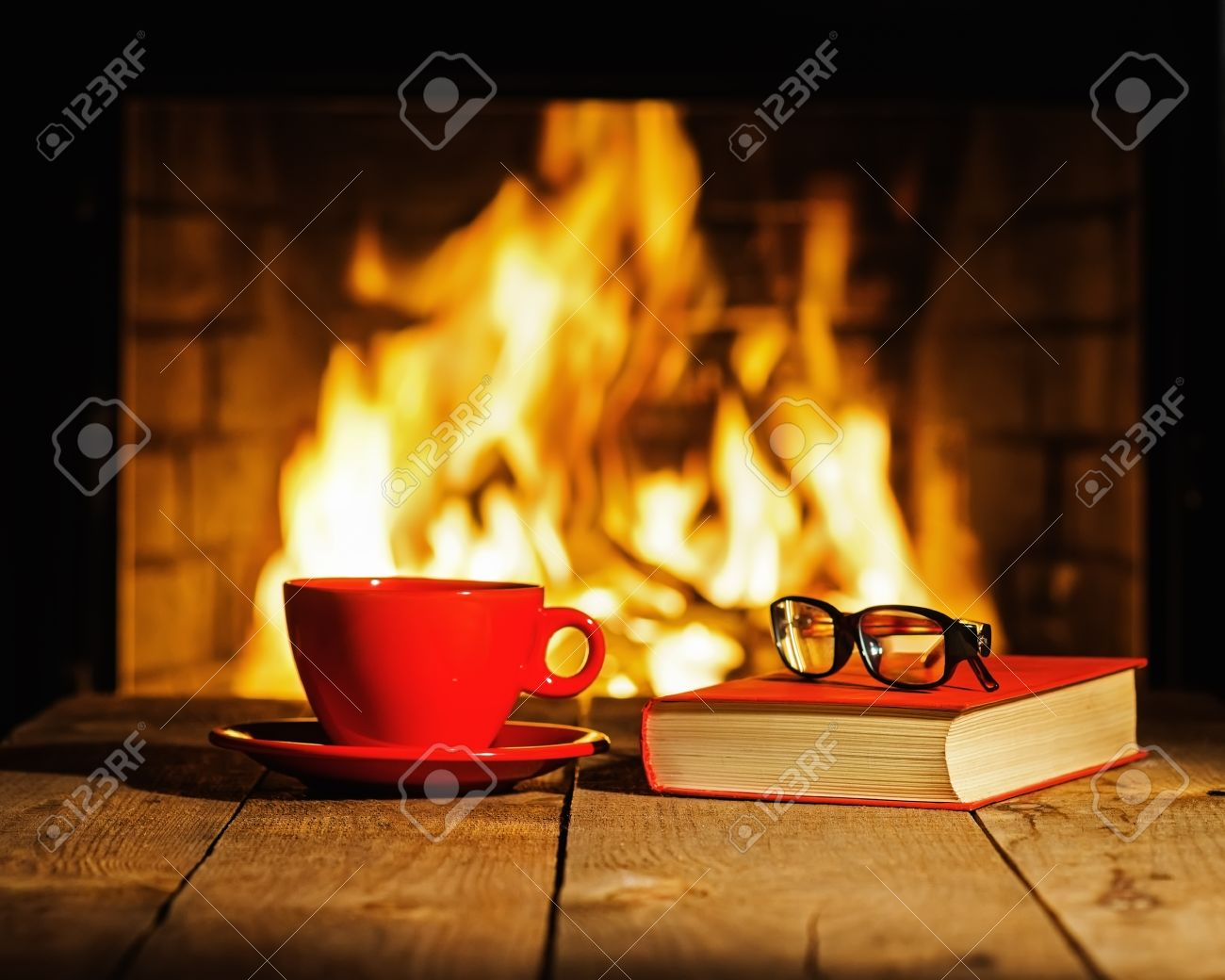 Red Cup Of Coffee Or Tea Glasses And Old Book On Wooden Table