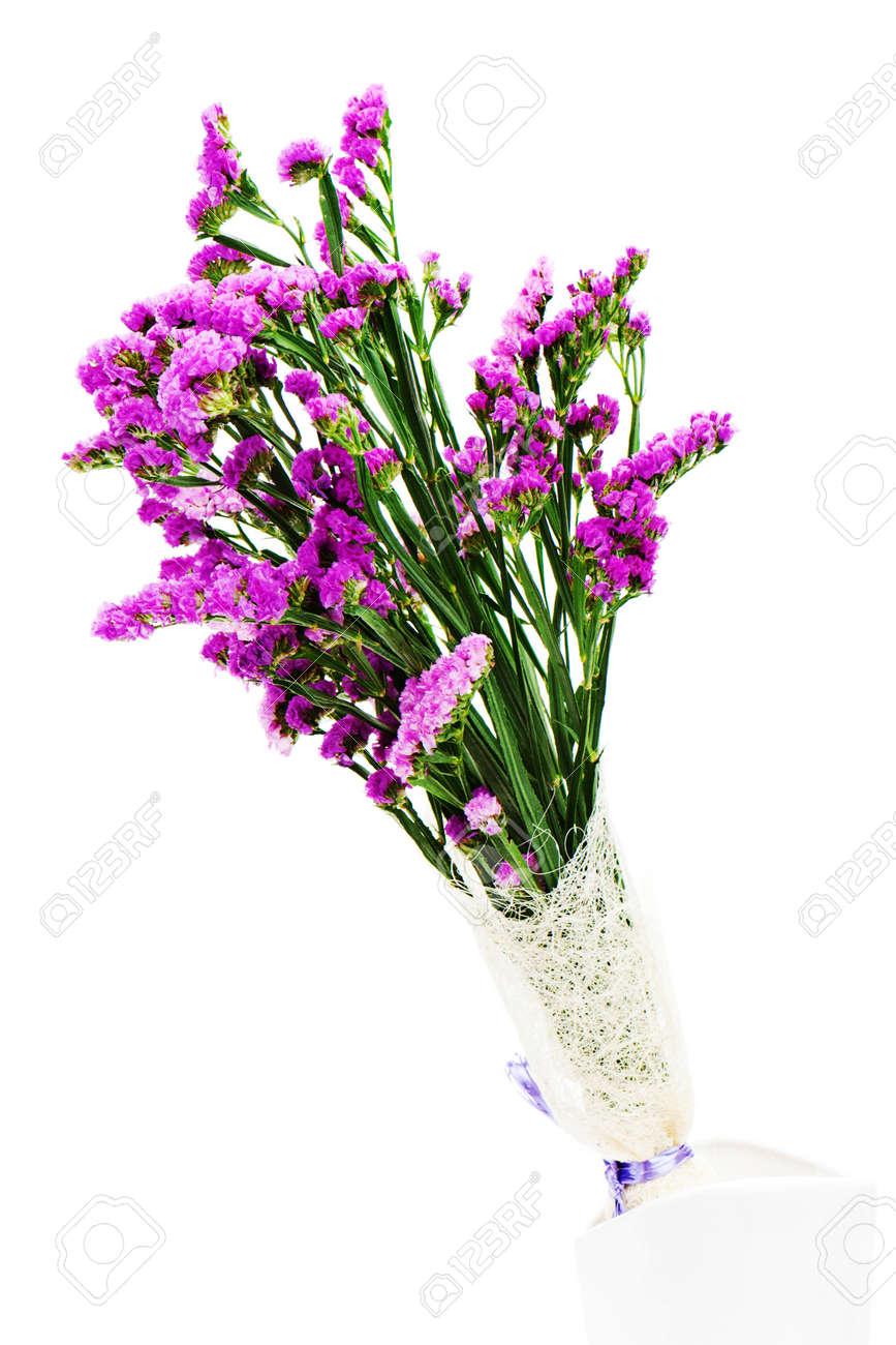 Bouquet from purple statice flowers arrangement centerpiece in bouquet from purple statice flowers arrangement centerpiece in vase isolated on white background stock photo mightylinksfo