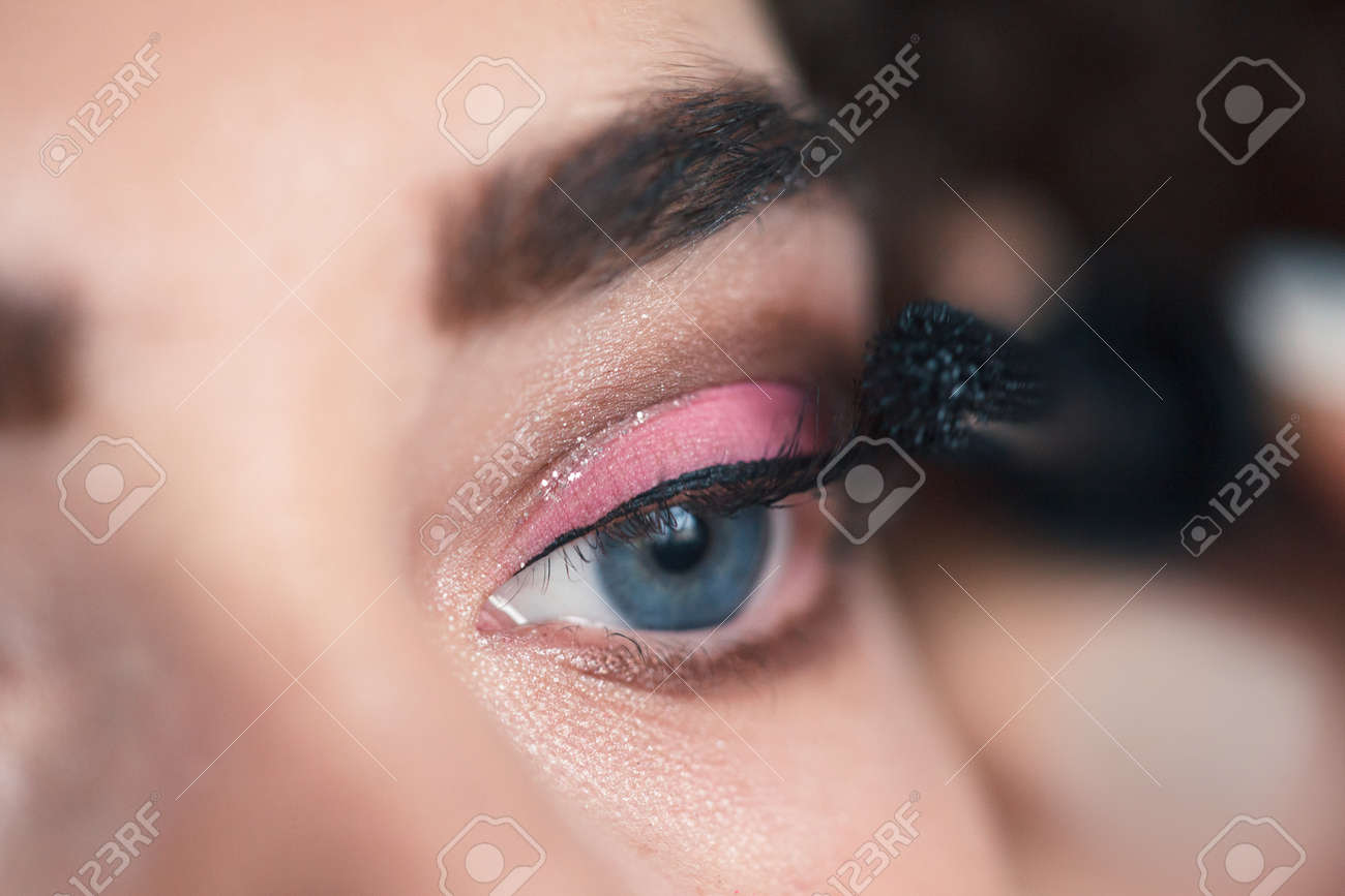 Closeup Of Makeup Artist Applying Smokey Eyes Makeup Beauty Stock