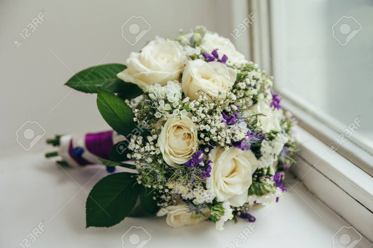 Wedding Bouquet Of White And Red Roses On A Bench Stock Photo