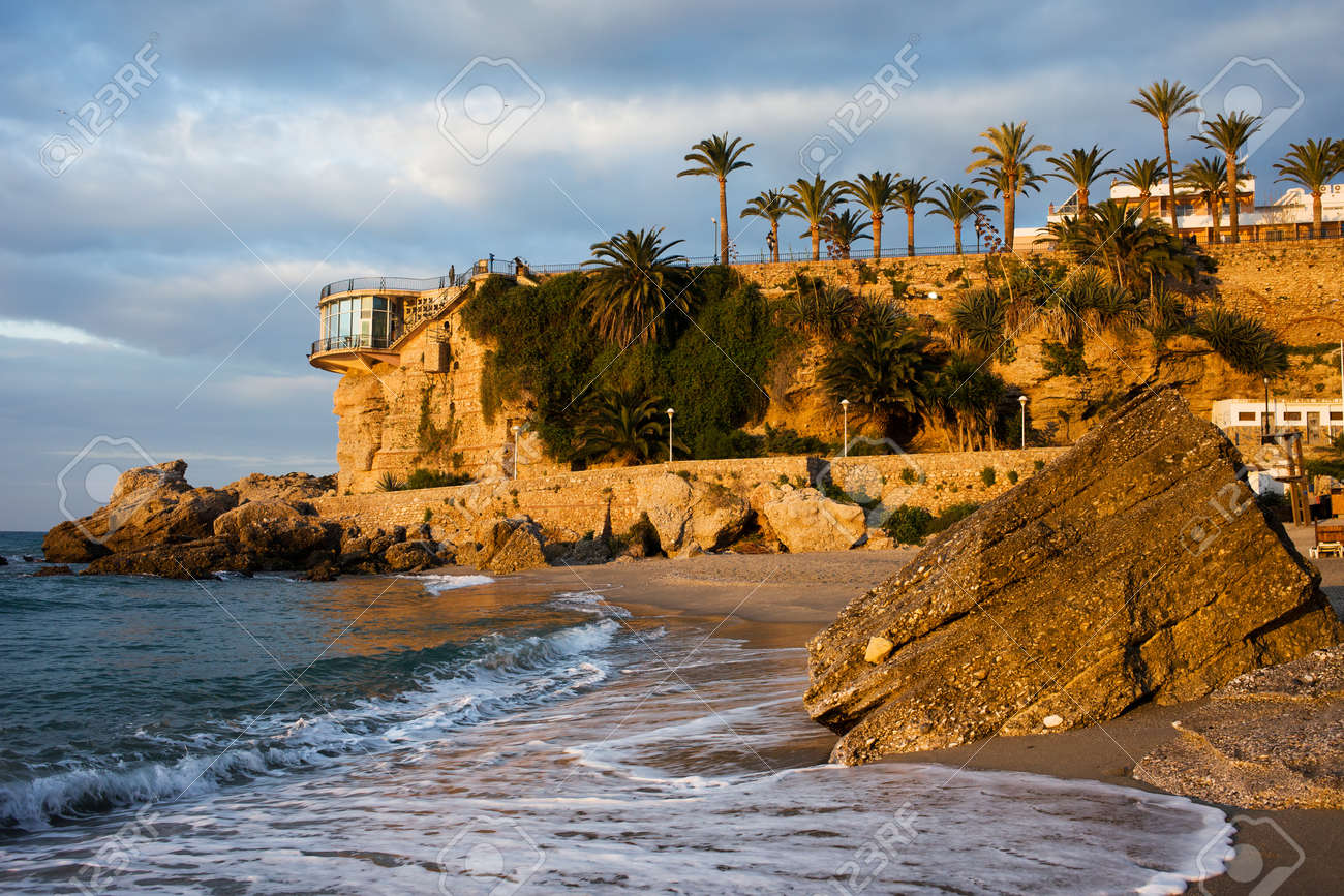Sunrise on the picturesque coastline of the Mediterranean Sea and Balcon de Europa famous vantage point in resort town of Nerja, Costa del Sol, Spain. - 13713336