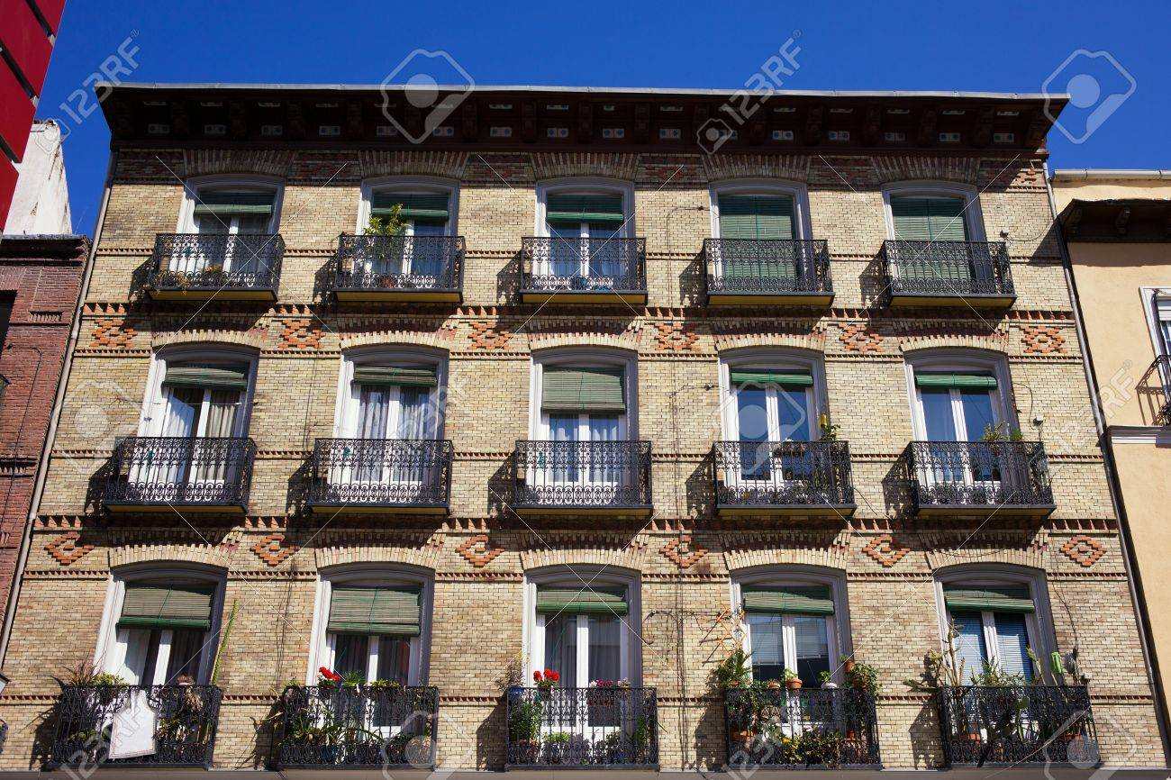 Old Apartment Building With Balconies Brick Facade In Madrid Spain Stock Photo