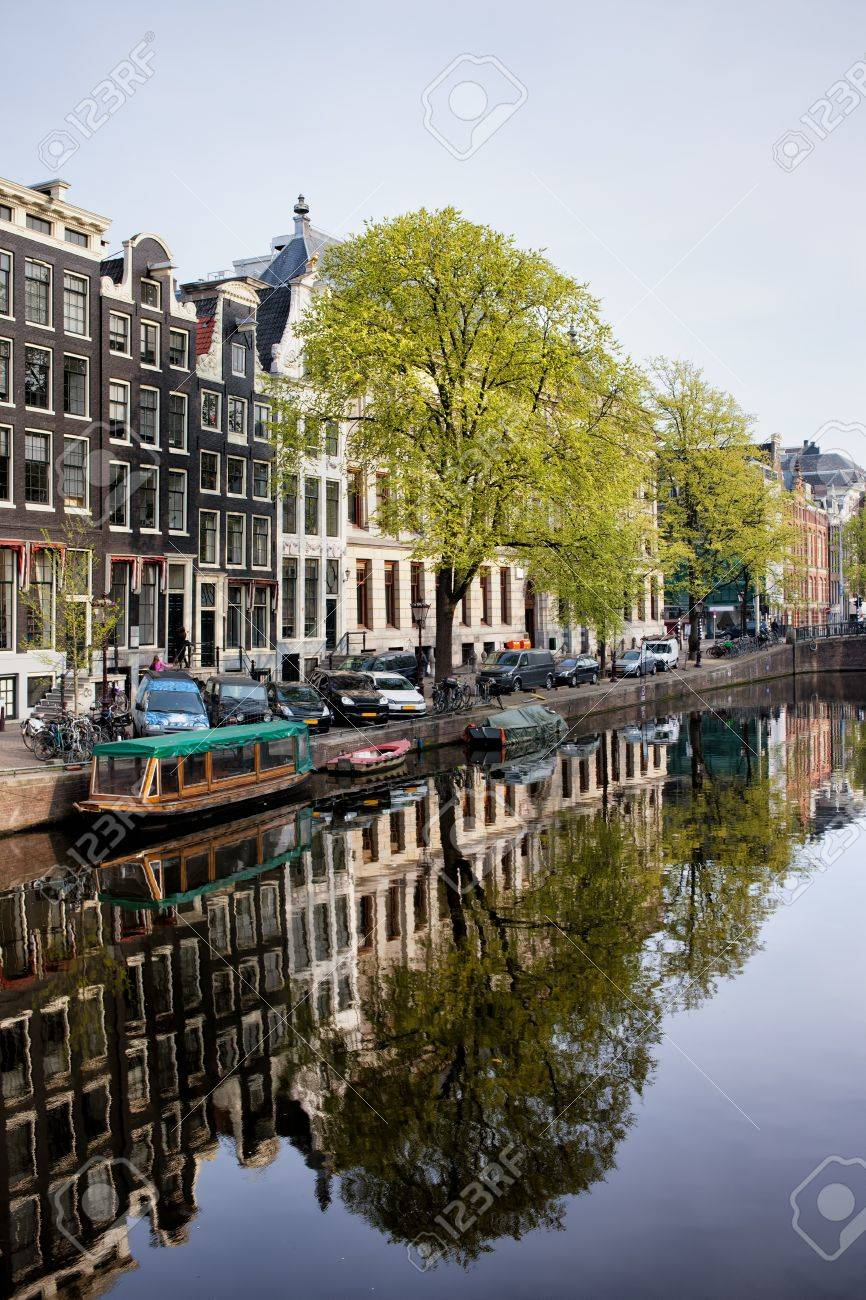 Houses along Singel canal historic waterfront, city of Amsterdam in spring, Holland. Stock Photo - 20217813