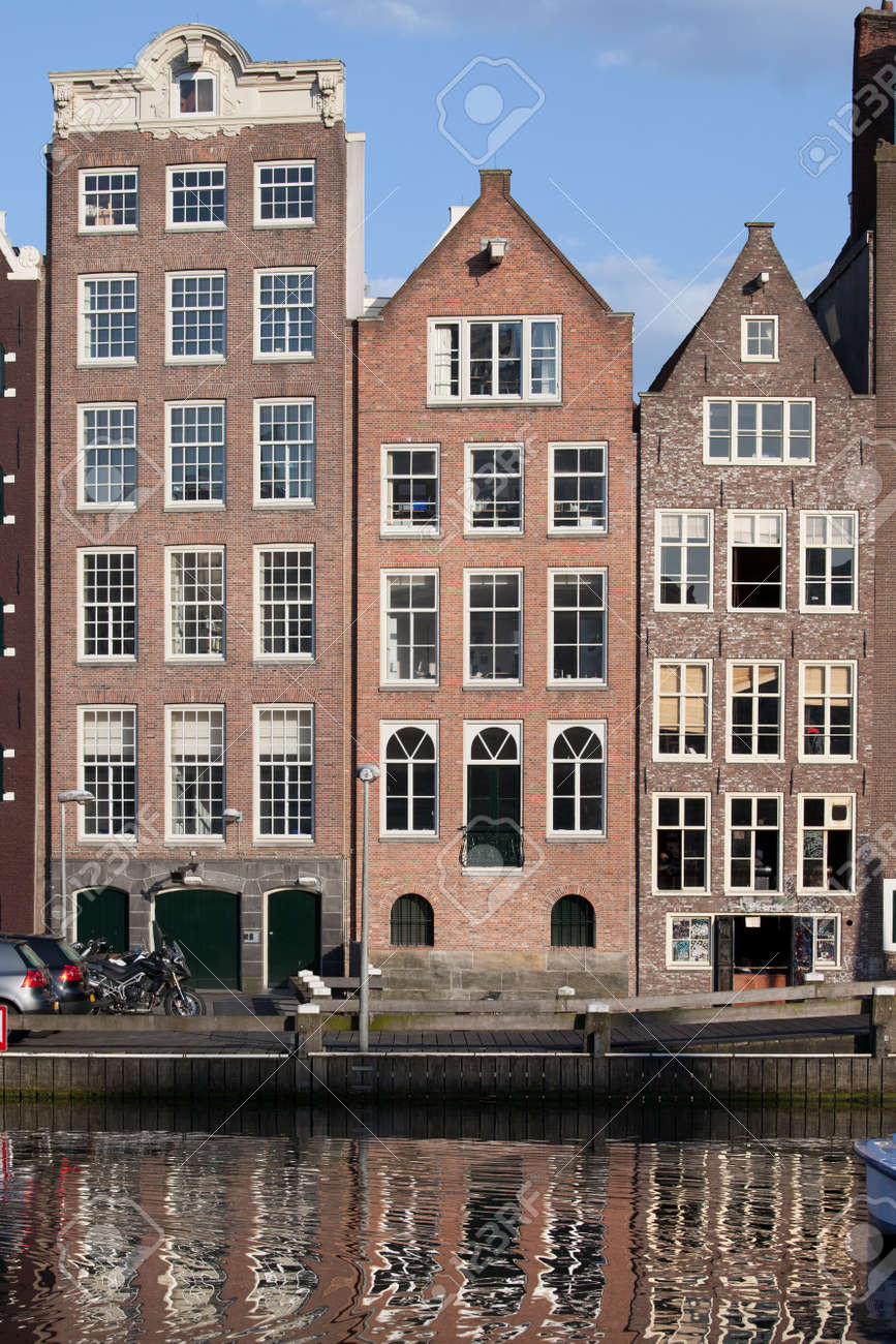 Dutch Style Row Houses By The Water In Amsterdam, Holland, Netherlands.  Stock Photo