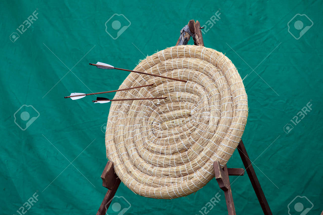 Traditional archery round coiled straw target on a stand with