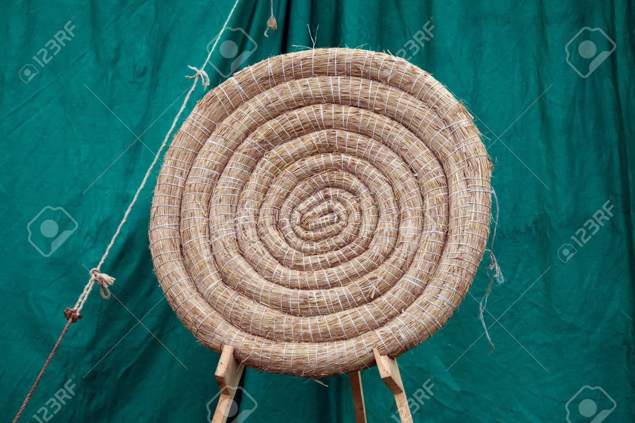 Traditional archery round coiled straw target on a stand