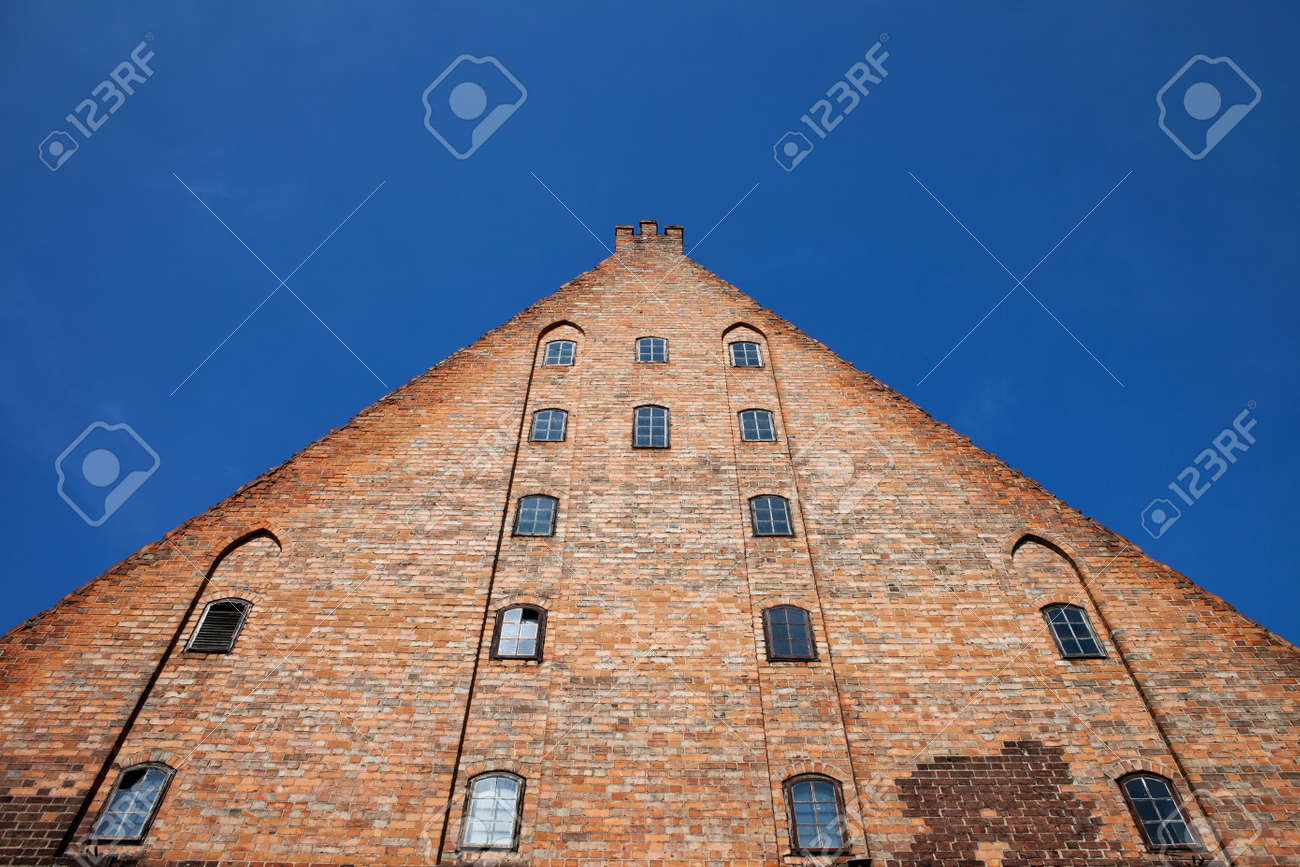 Great Mill (Wielki M?yn) in Gdansk, Poland, Europe, built by the Teutonic Knights in 1350, historical city landmark, pyramid, triangle shape, medieval brick structure - 62093587