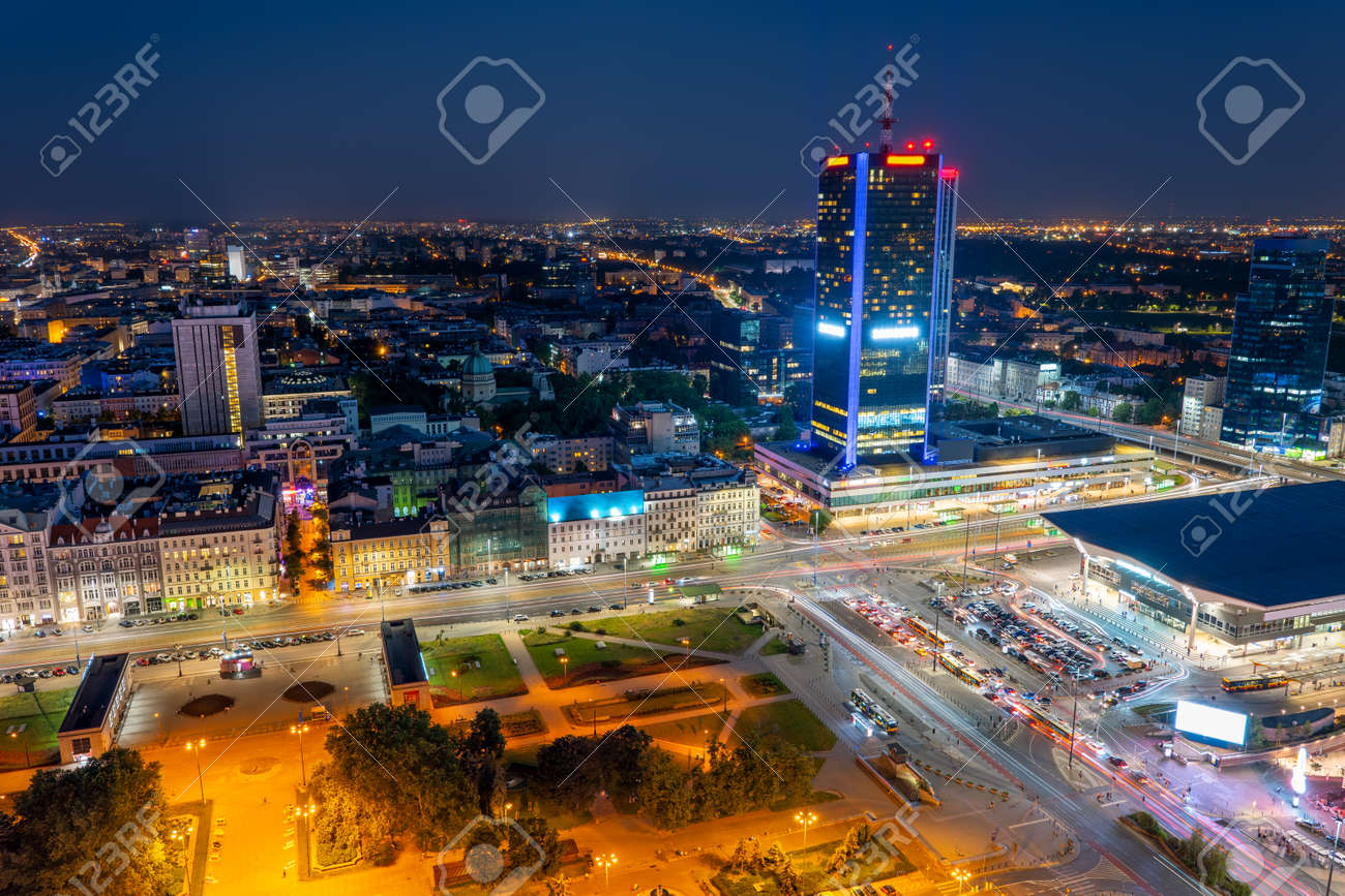 Warsaw cityscape in Poland, aerial view at night of the Polish capital city centre, central railway station on the right. - 127580999
