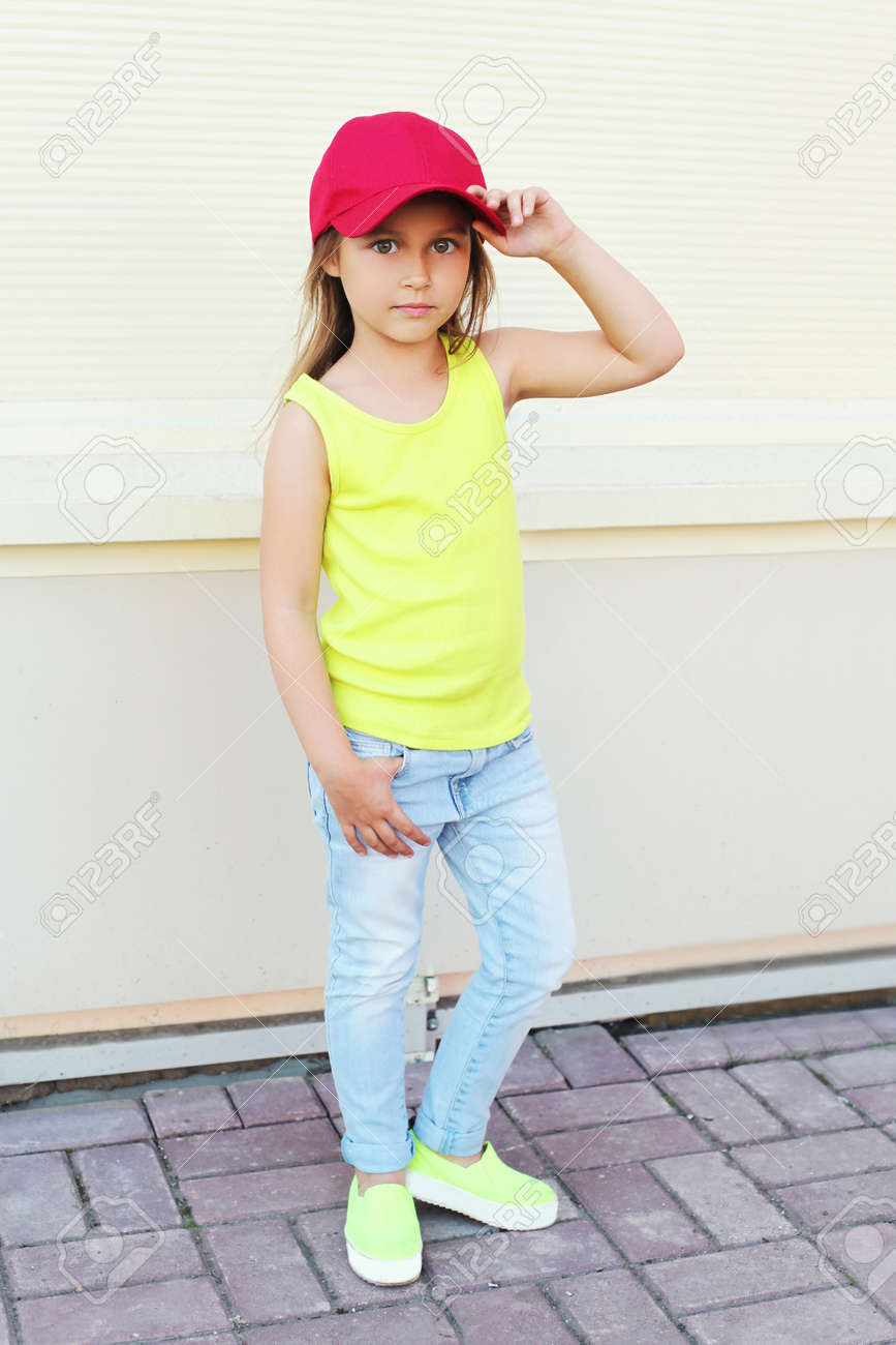 Fashion little girl child wearing a baseball red cap in city Stock Photo -  61130216 4746ee58a41