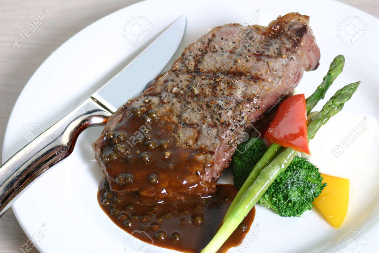 Grilled steak served with asparagus and broccoli Stock Photo - 296190