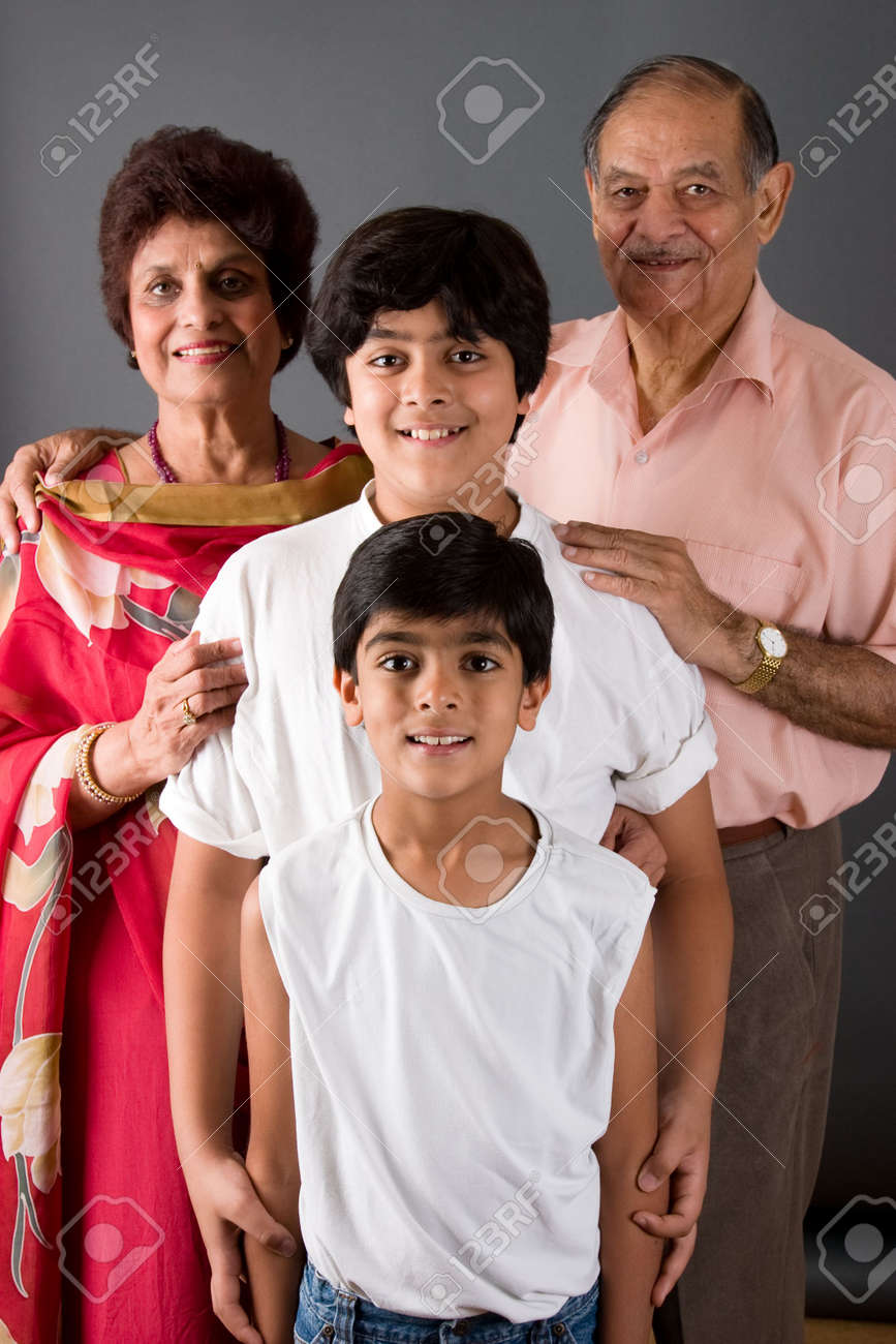 Two children with their grandparents against a gray background Stock Photo - 3519708
