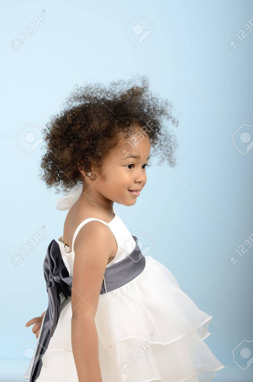 Little girl in formal dress from the side Stock Photo - 18061235