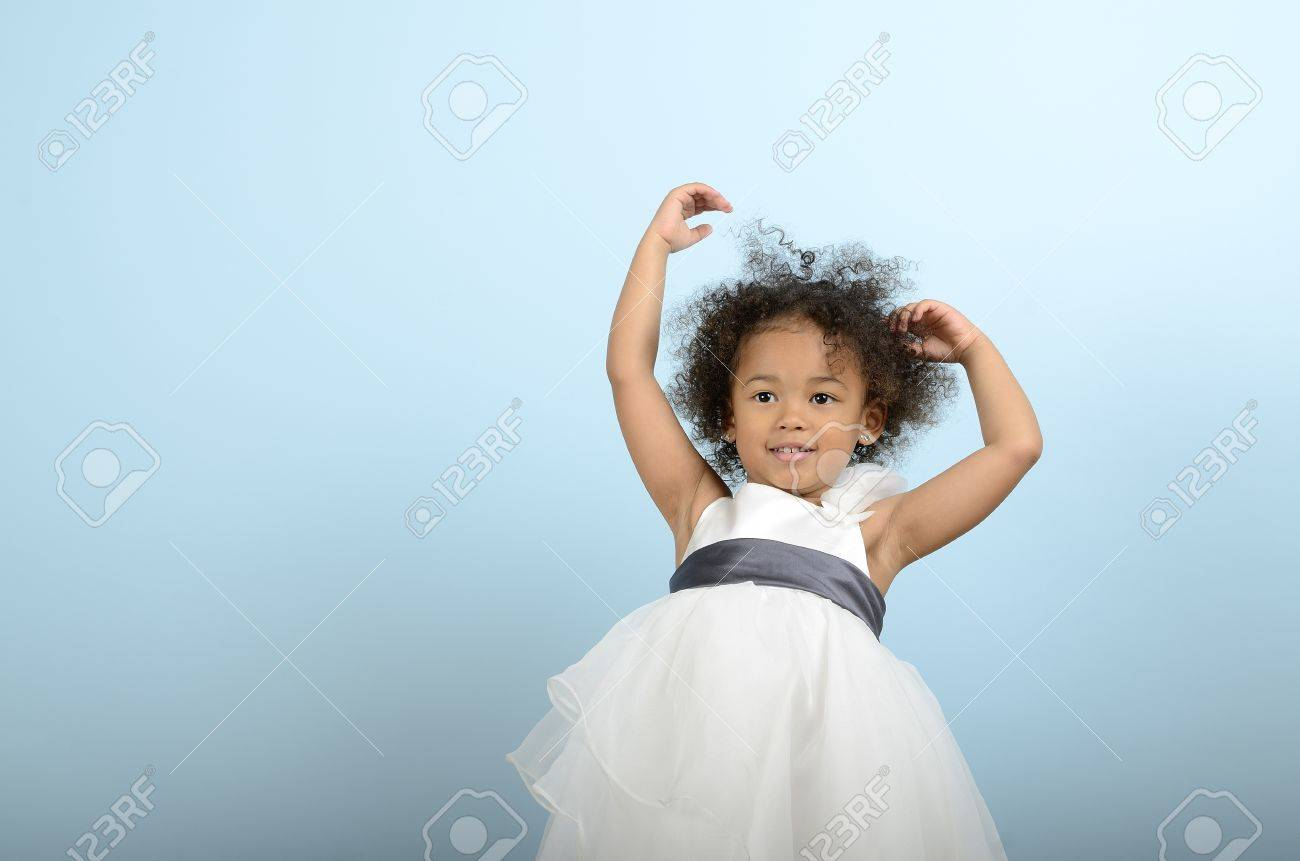 Mixed race girl holding up her arms Stock Photo - 18061242