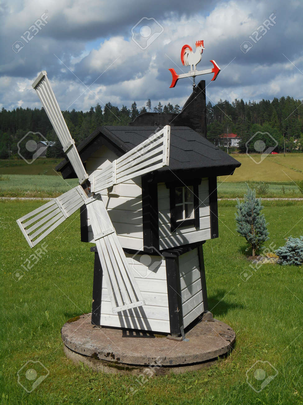 Small Wooden Windmill Is Used As A Yard Decoration Stock Photo