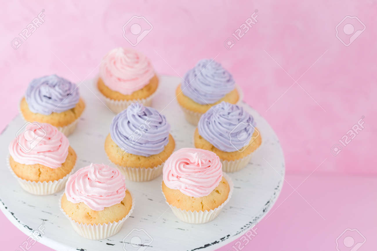 Cupcakes With Pink And Violet Buttercream Standing On Pastel