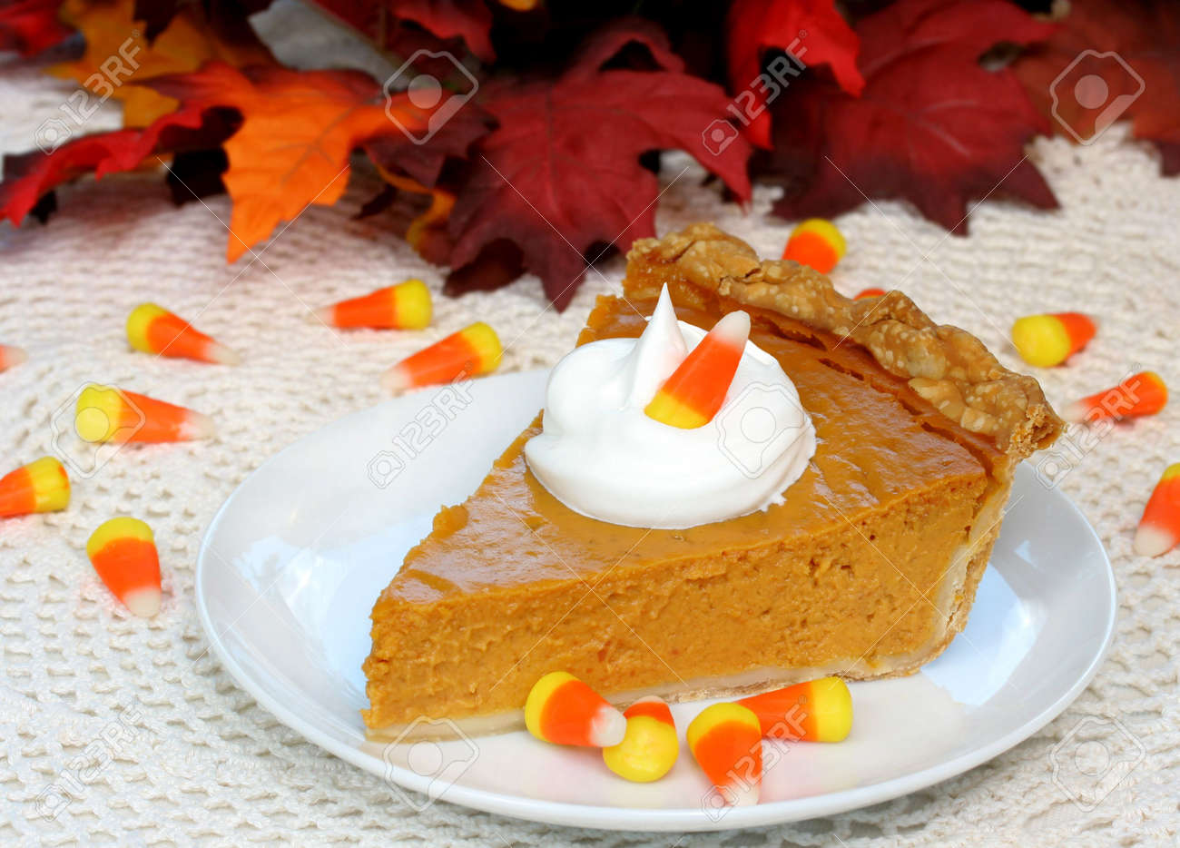 One slice of Pumpkin Pie with Candy Corn and Fall Leaves Stock Photo - 3447799