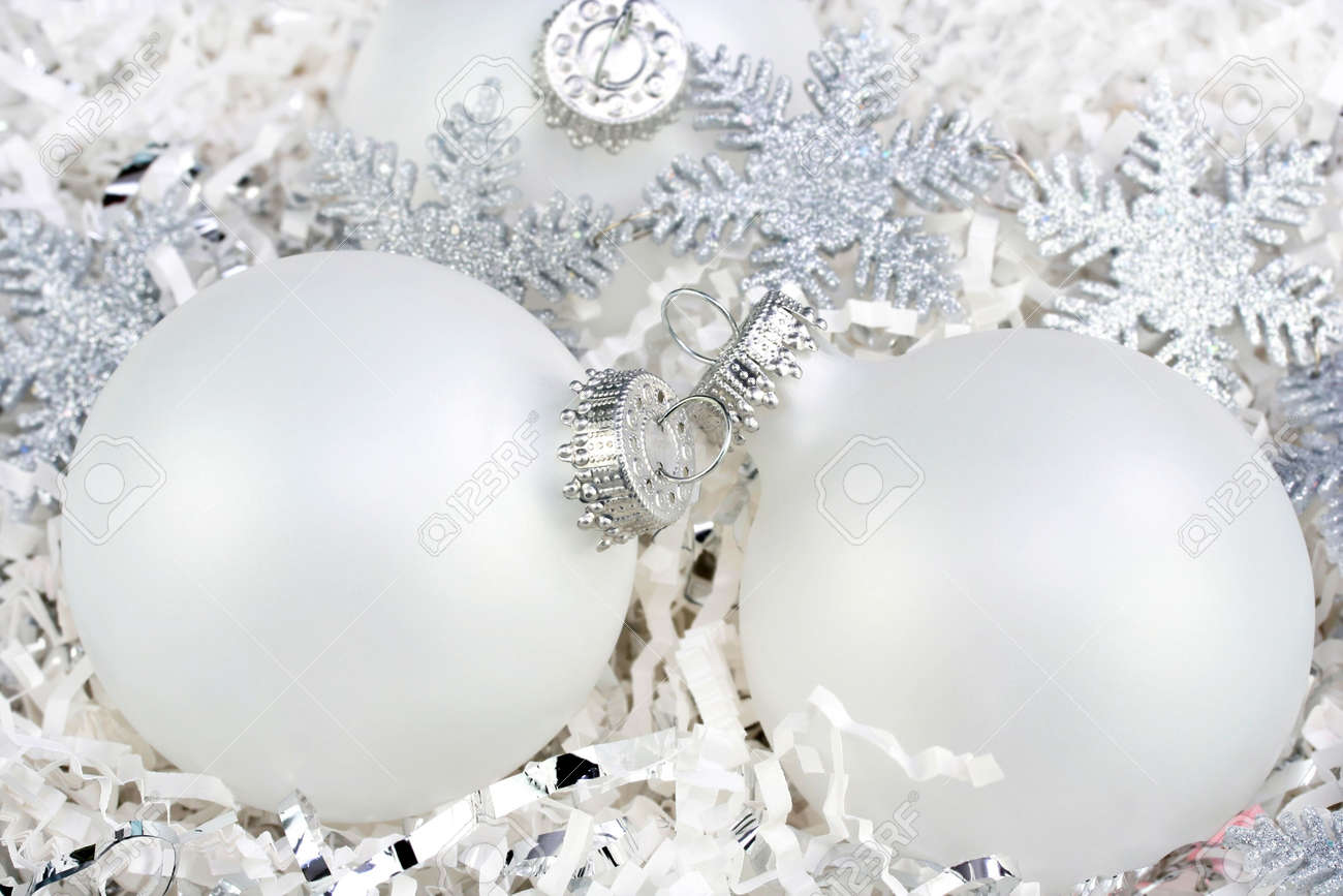 Three White Christmas Ball Ornaments Nestled In White Paper With ...