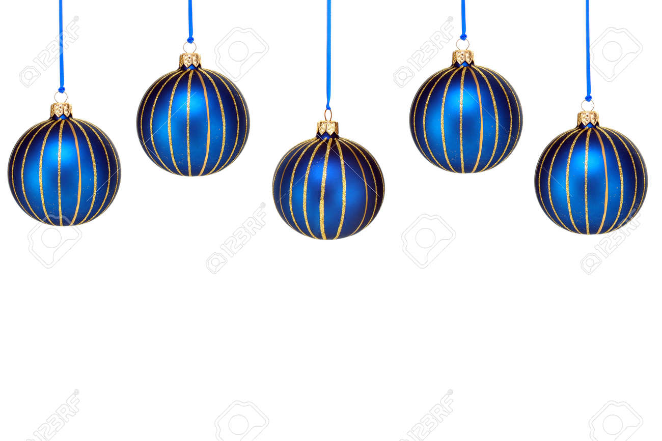 Five blue and gold Christmas ornaments form a top border Isolated