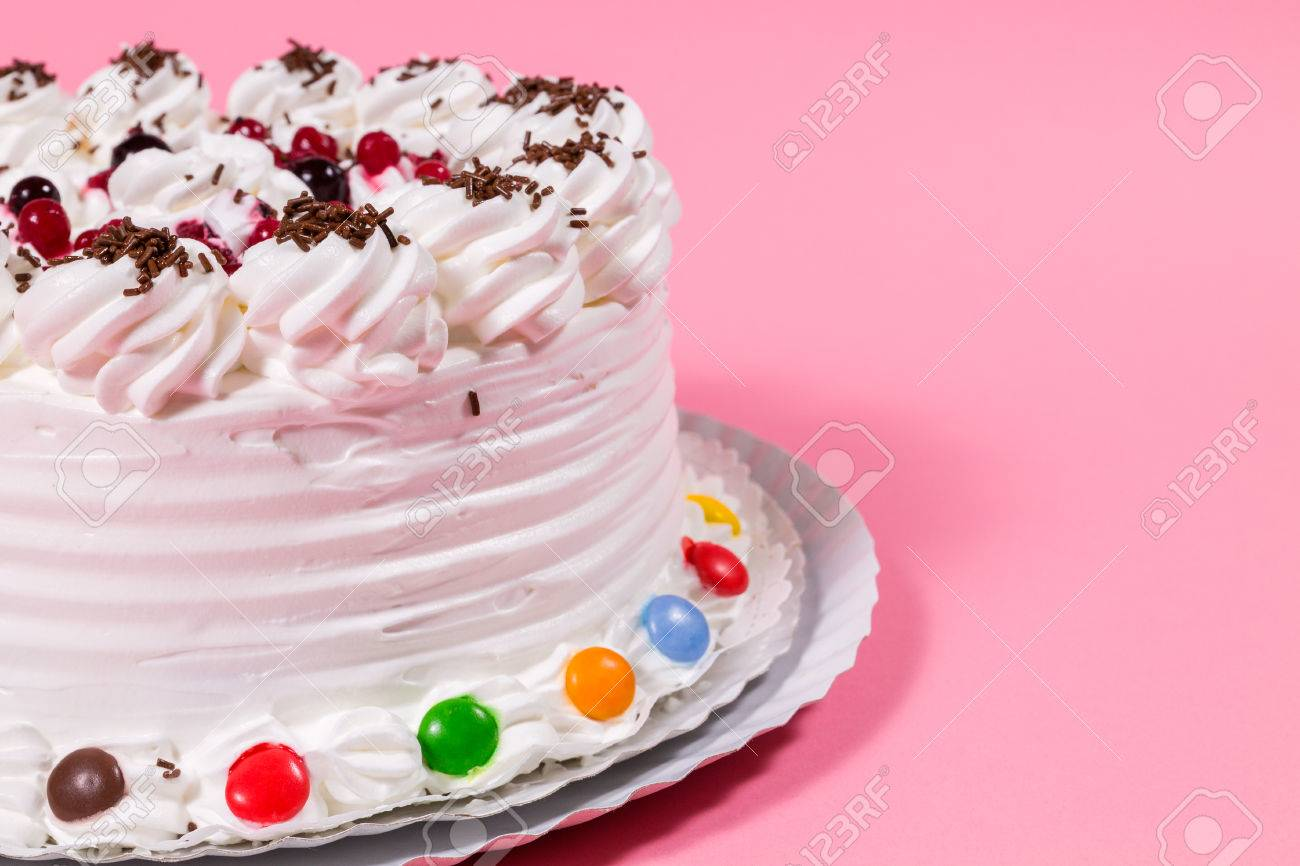 Tasty Creamy Birthday Cake Colorful Candy Adorned On Pink Background