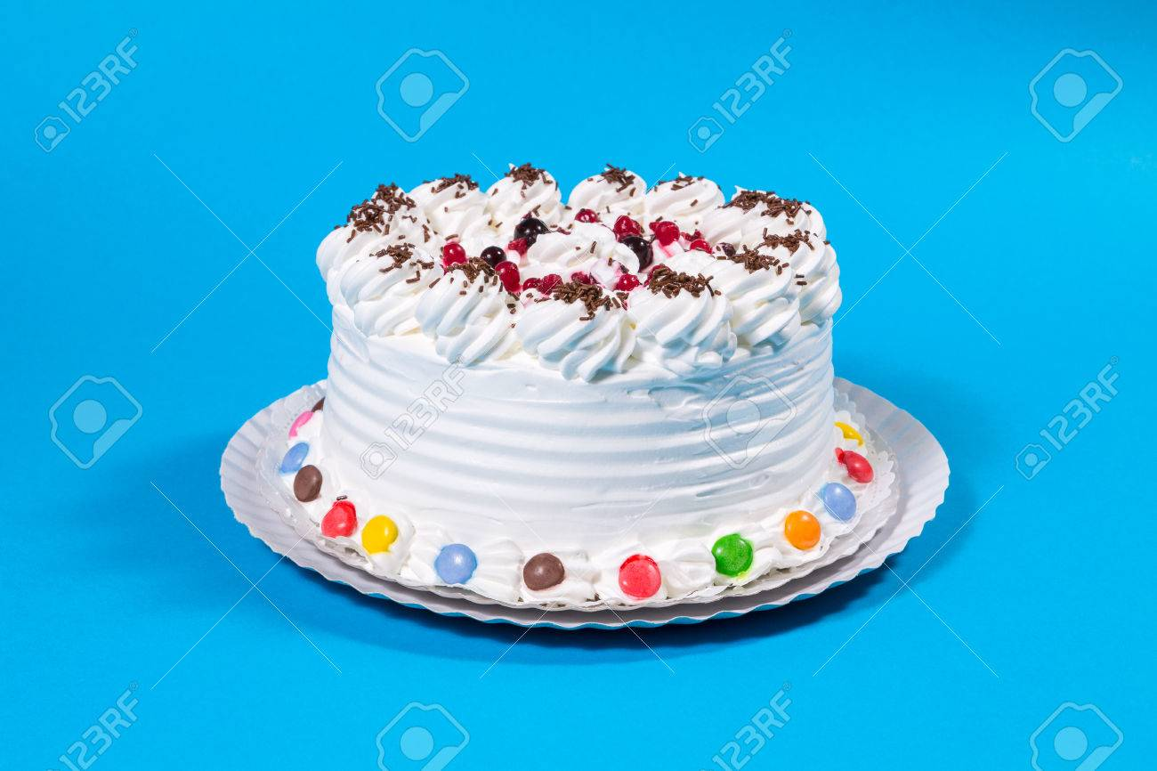 Tasty Creamy Birthday Cake Colorful Candy Adorned On Blue Background