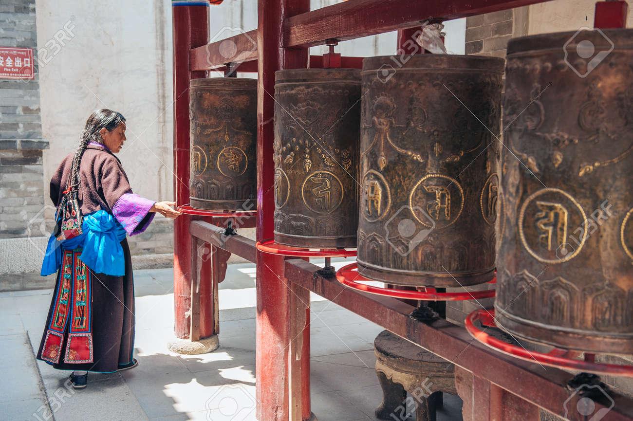 Qinghai Province, China June 25, 2012: Tibetan woman praying