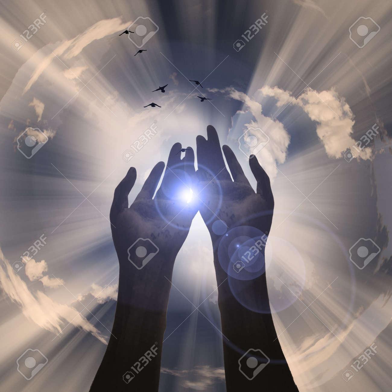 Hands reveal light Stock Photo - 6144267