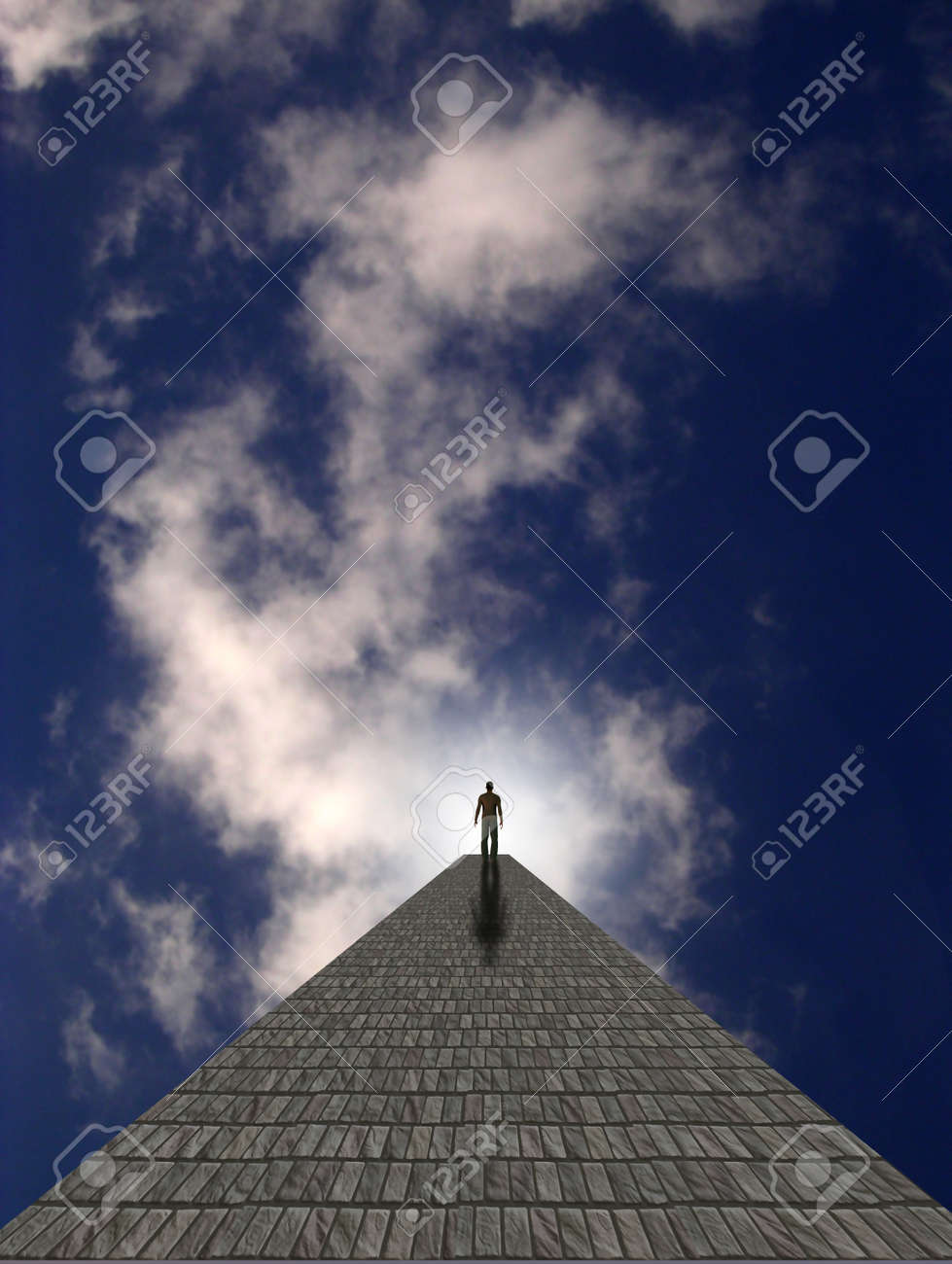 Man atop stone in clouds Stock Photo - 9106370