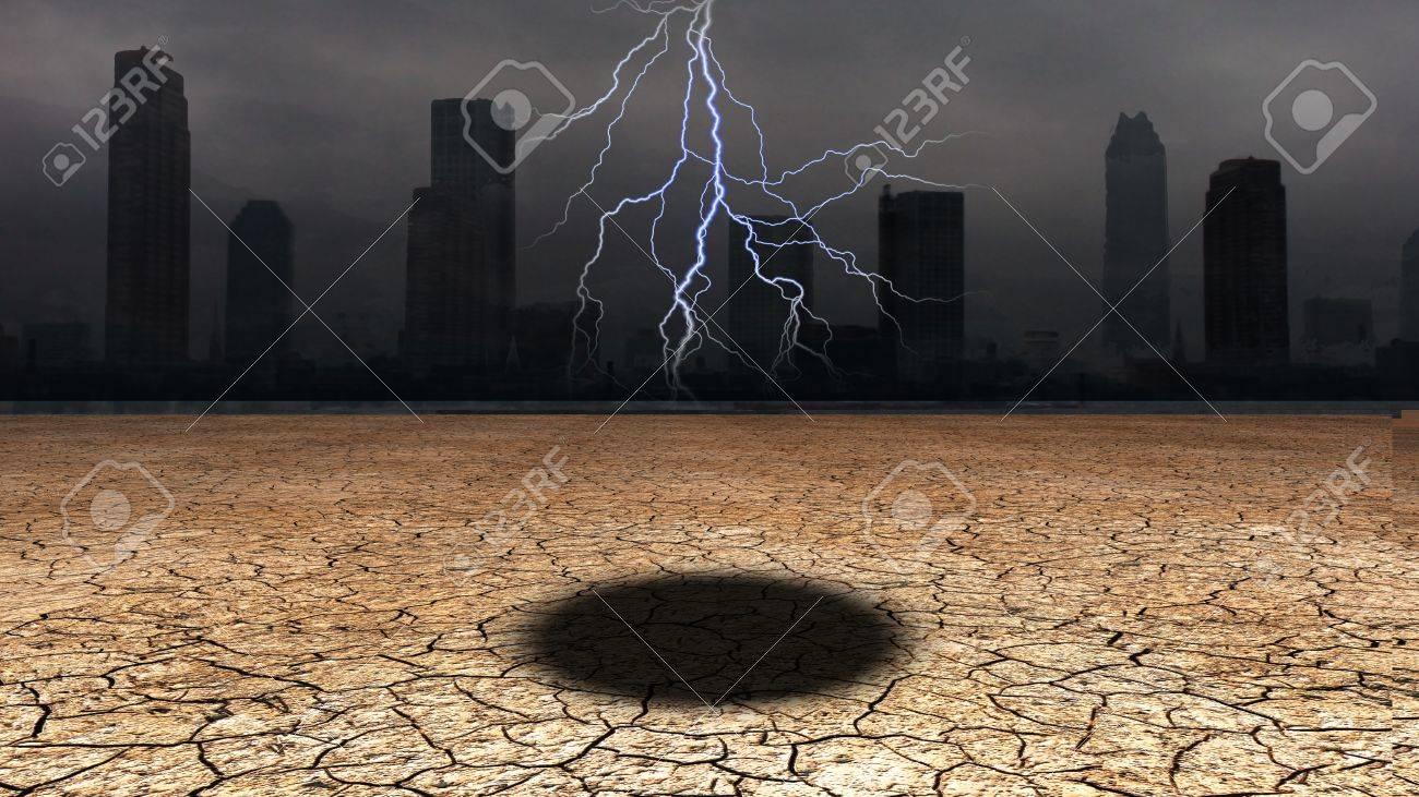 Dark city with hole in desert floor Stock Photo - 12784337
