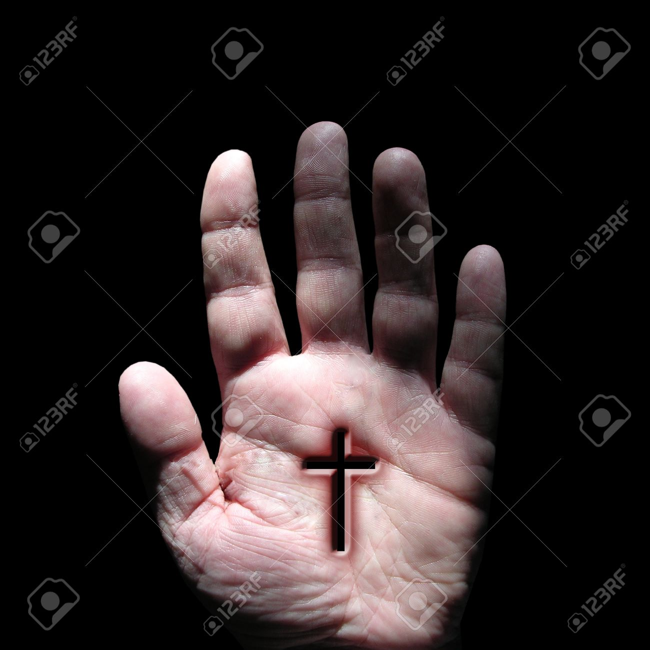 cross symbol at hand stock photo picture and royalty free image