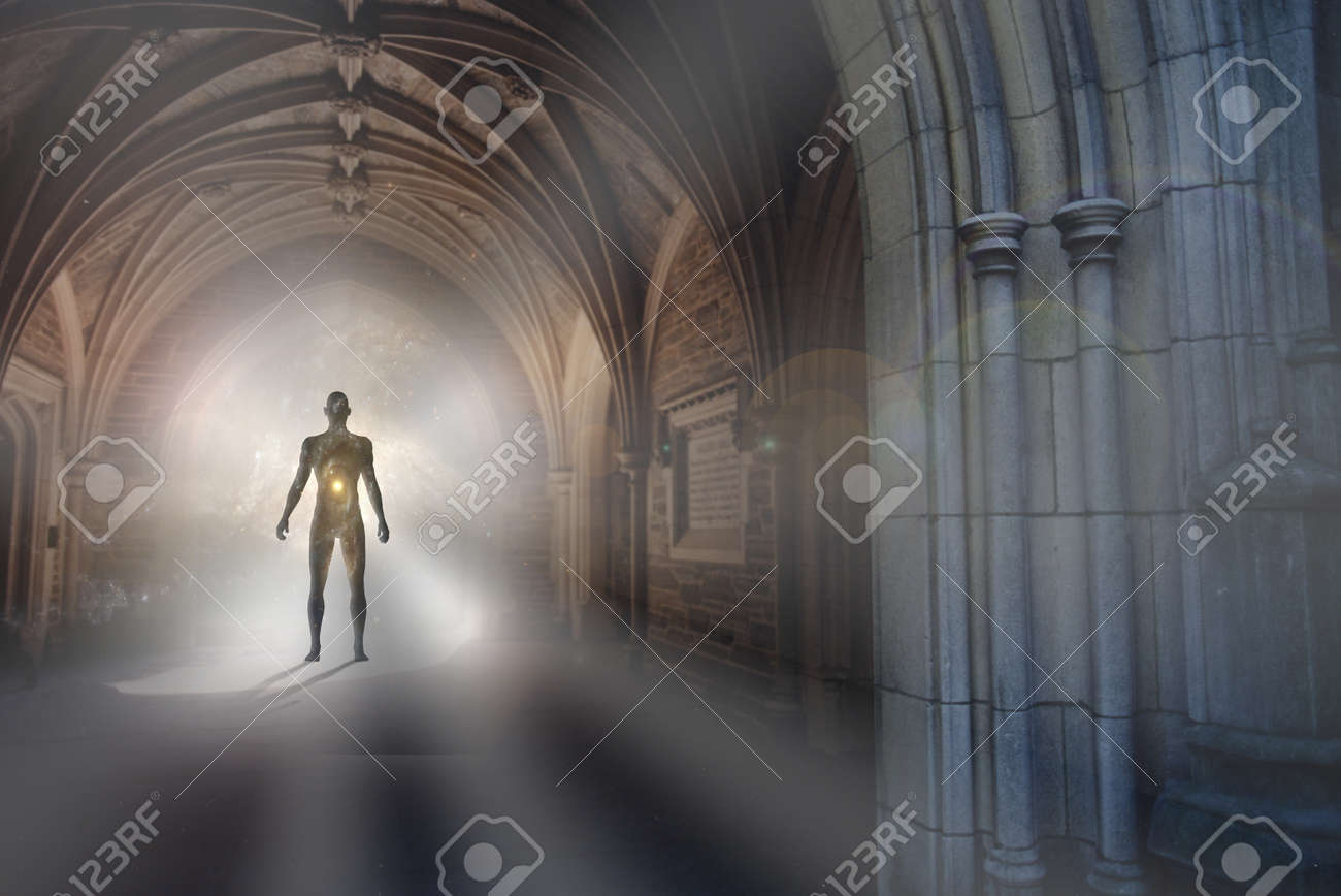 Human Silhouette With Universe Inside Stands In Gothic Archway Light Illuminating The Path Stock