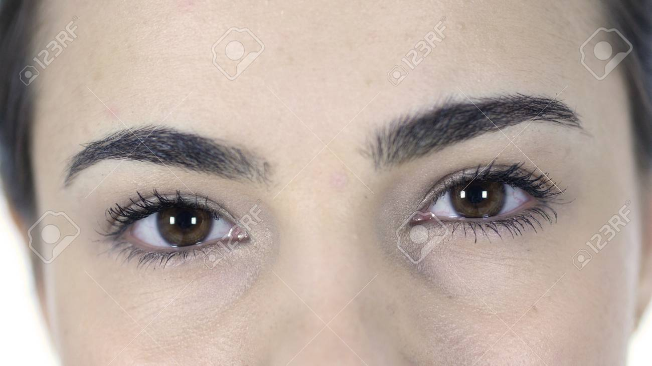 blinking eyes of woman isolated on white background stock photo
