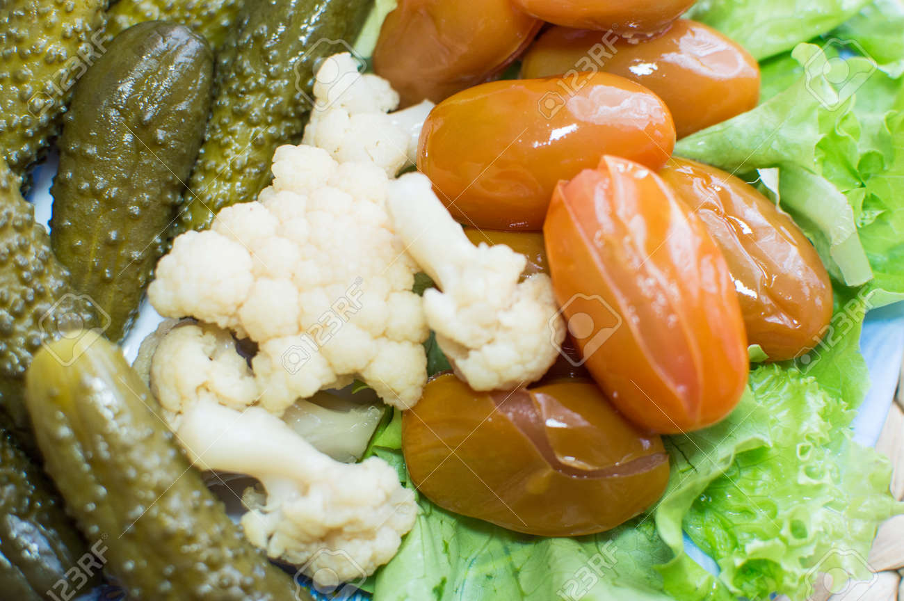 Pickled vegetables on the plate. Assorted food - 57128160