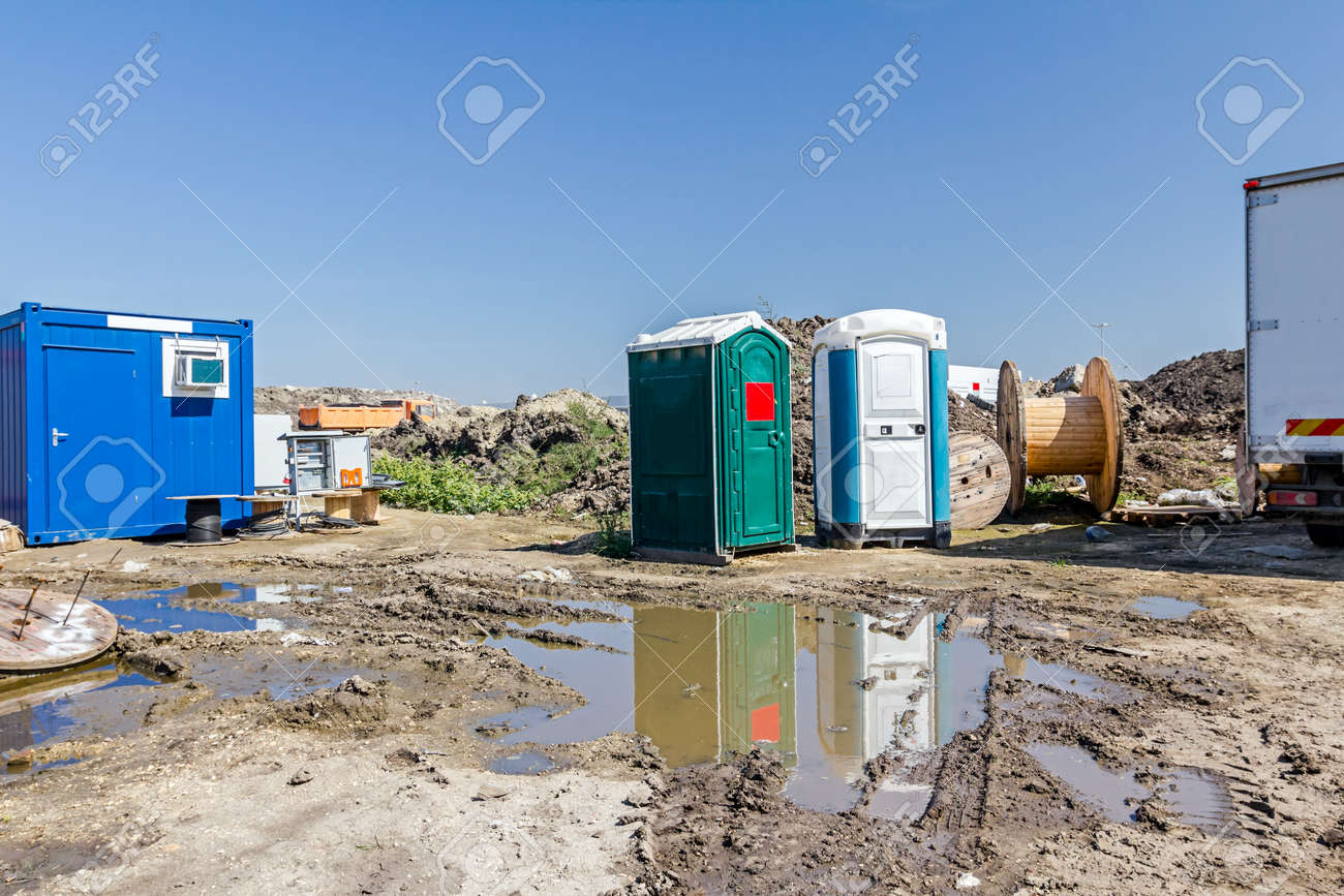 The group of transportable public street toilet is placed at building site. - 60959830