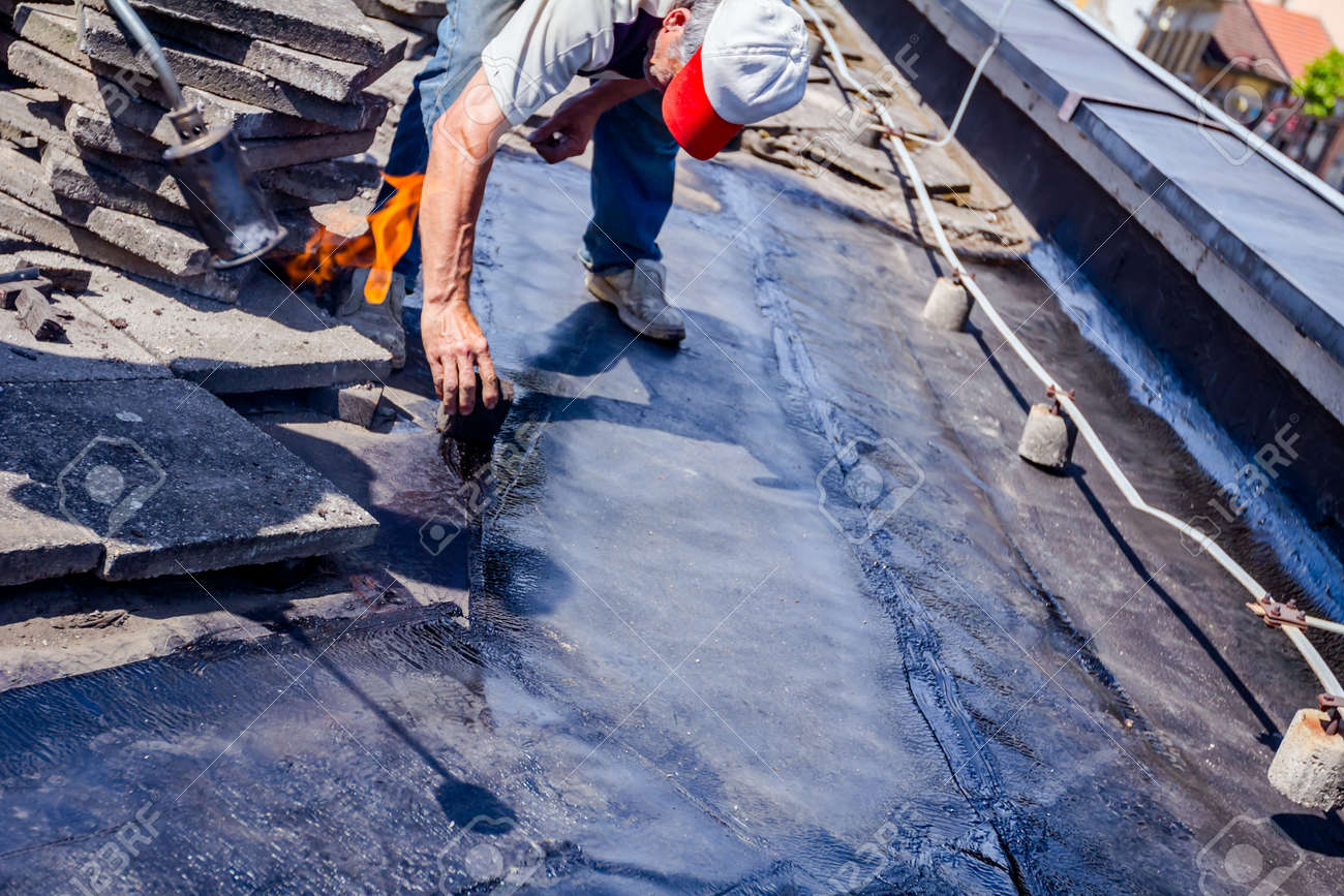 Heating And Melting Of Bitumen Surface By Flame From Gas Torch Stock Photo Picture And Royalty Free Image Image 102250435
