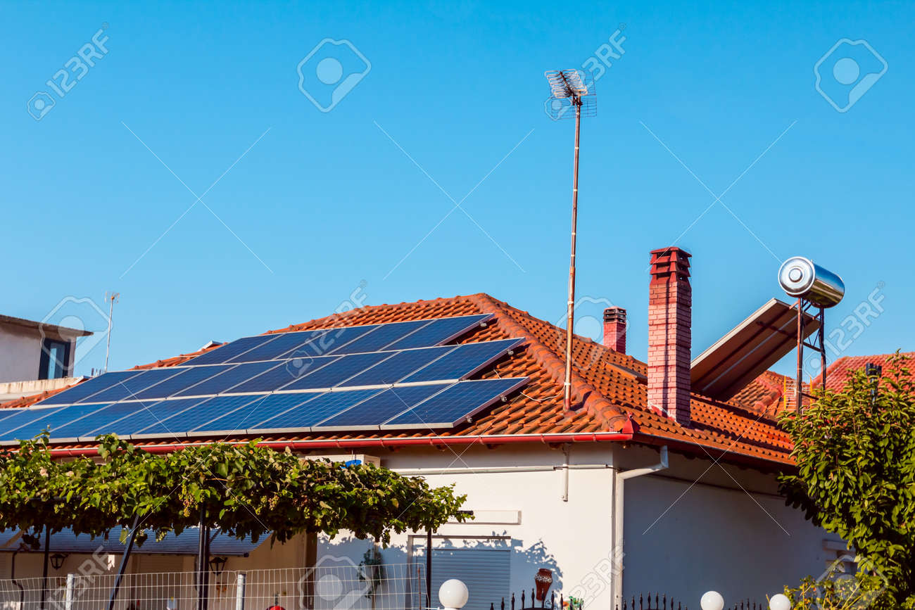 Solar cell panels are using renewable sun energy for making electricity, placed on house roof. Modern energy saving technology - 113797162
