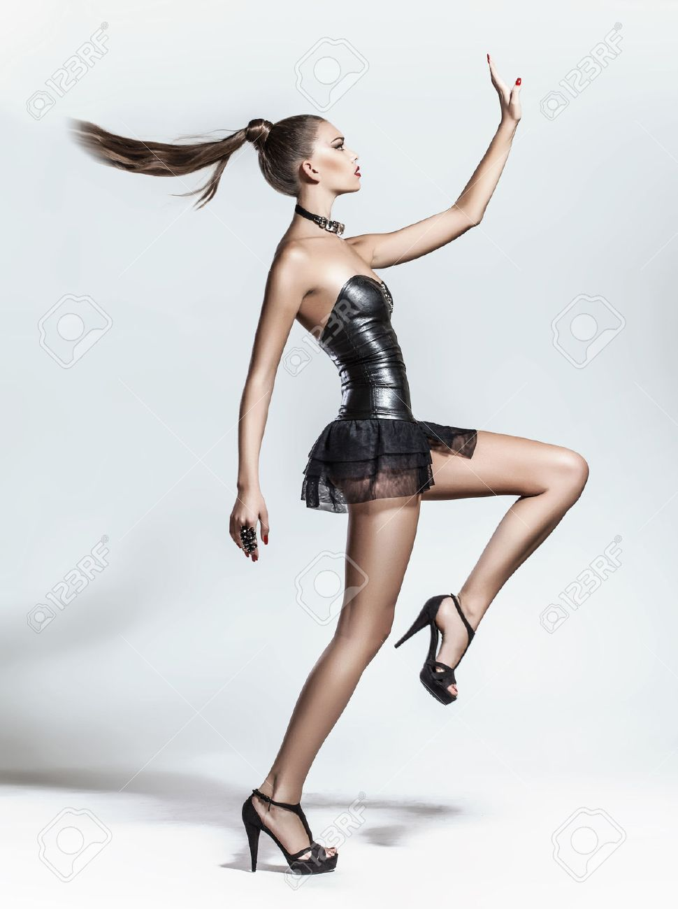 Fashion model posing on white background in the studio Stock Photo - 24368617