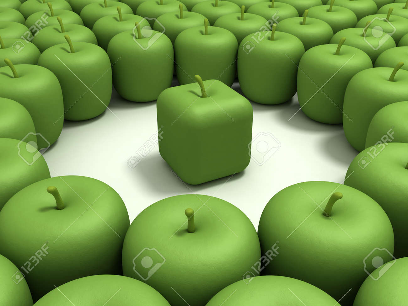 Green apple of the cubic form in an environment of usual green apples. Stock Photo - 11888030