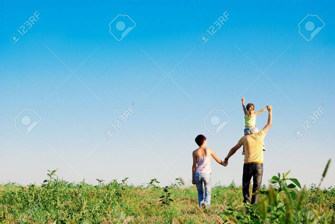 happy family in a meadow Stock Photo - 10871791