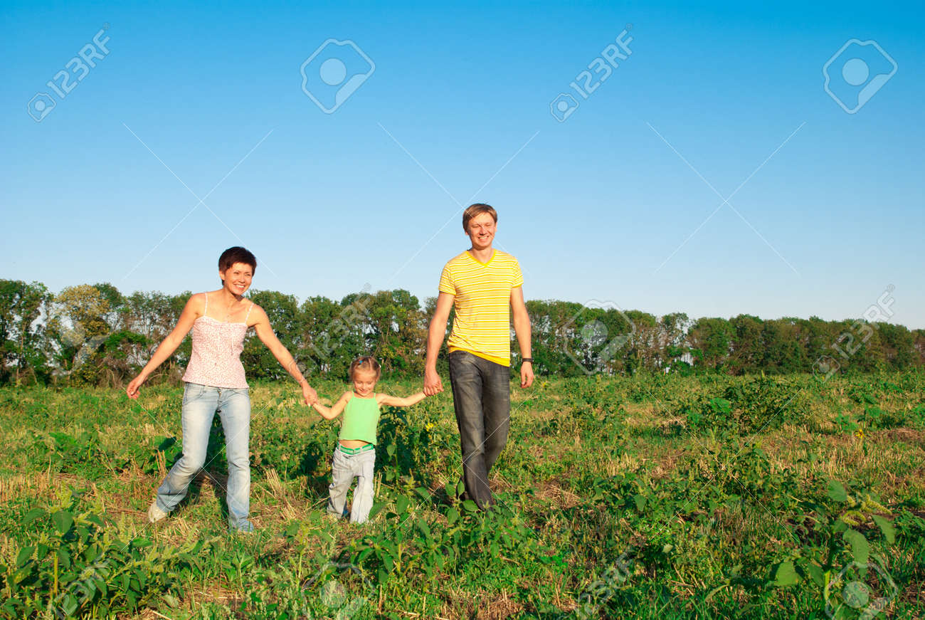 happy family in a meadow Stock Photo - 11065116