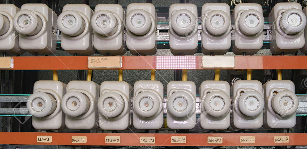 old electrical fuse box with porcelain fuses stock photo, picture three-phase electric power old electrical fuse box with porcelain fuses stock photo 89353763