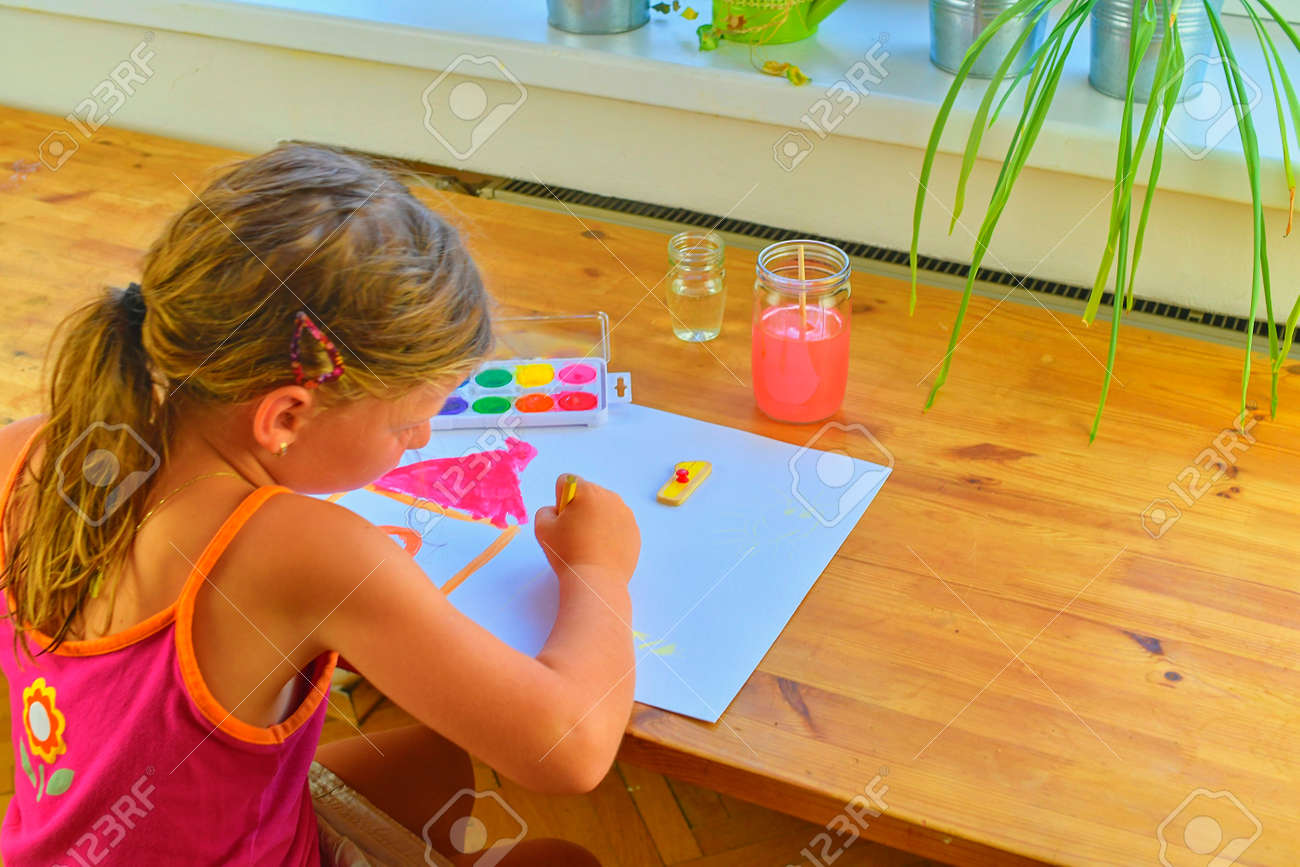 Cute little girl painting picture of house. Mortage concept. Selective focus, small DOF - 108206273