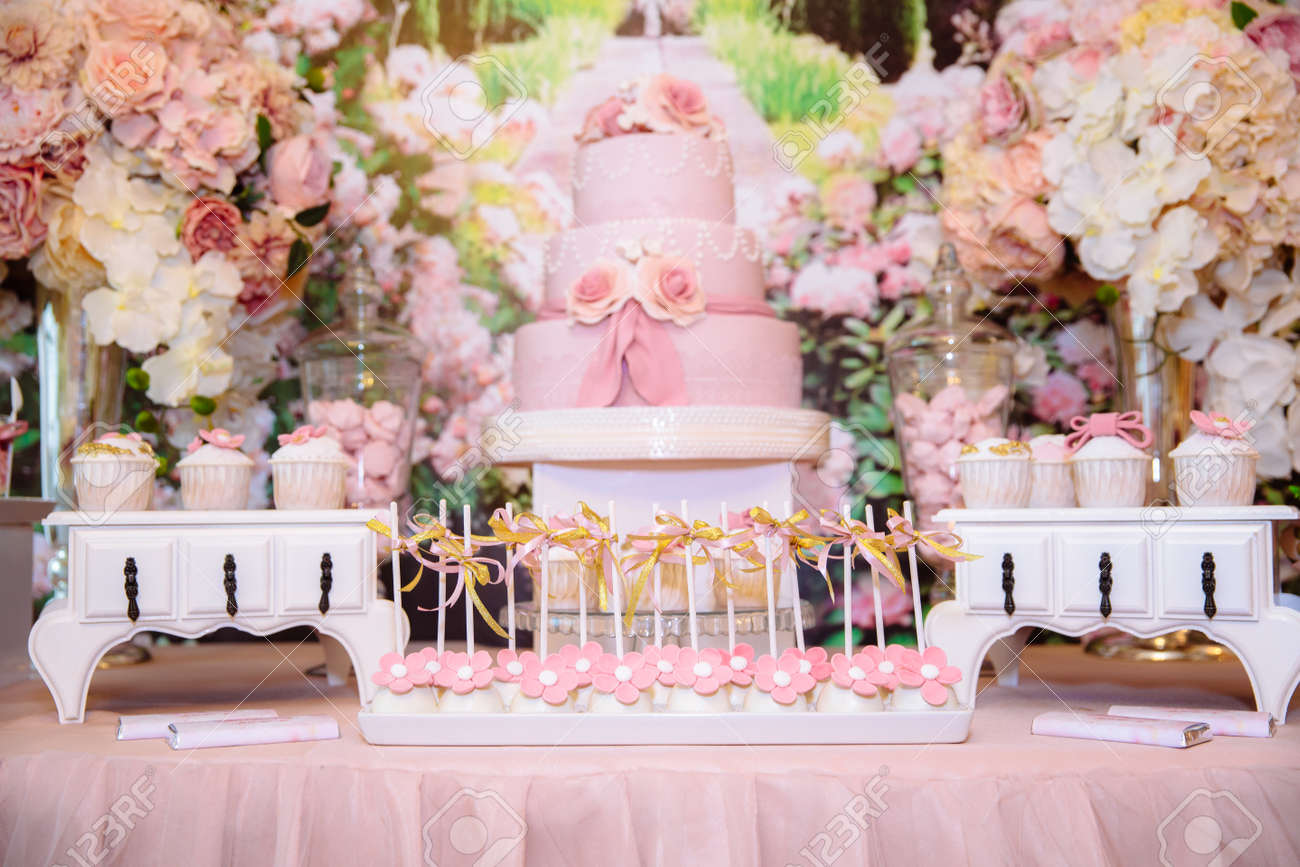 Wedding Cake Table.Candy Bar And Wedding Cake Table With Sweets Buffet With Cupcakes
